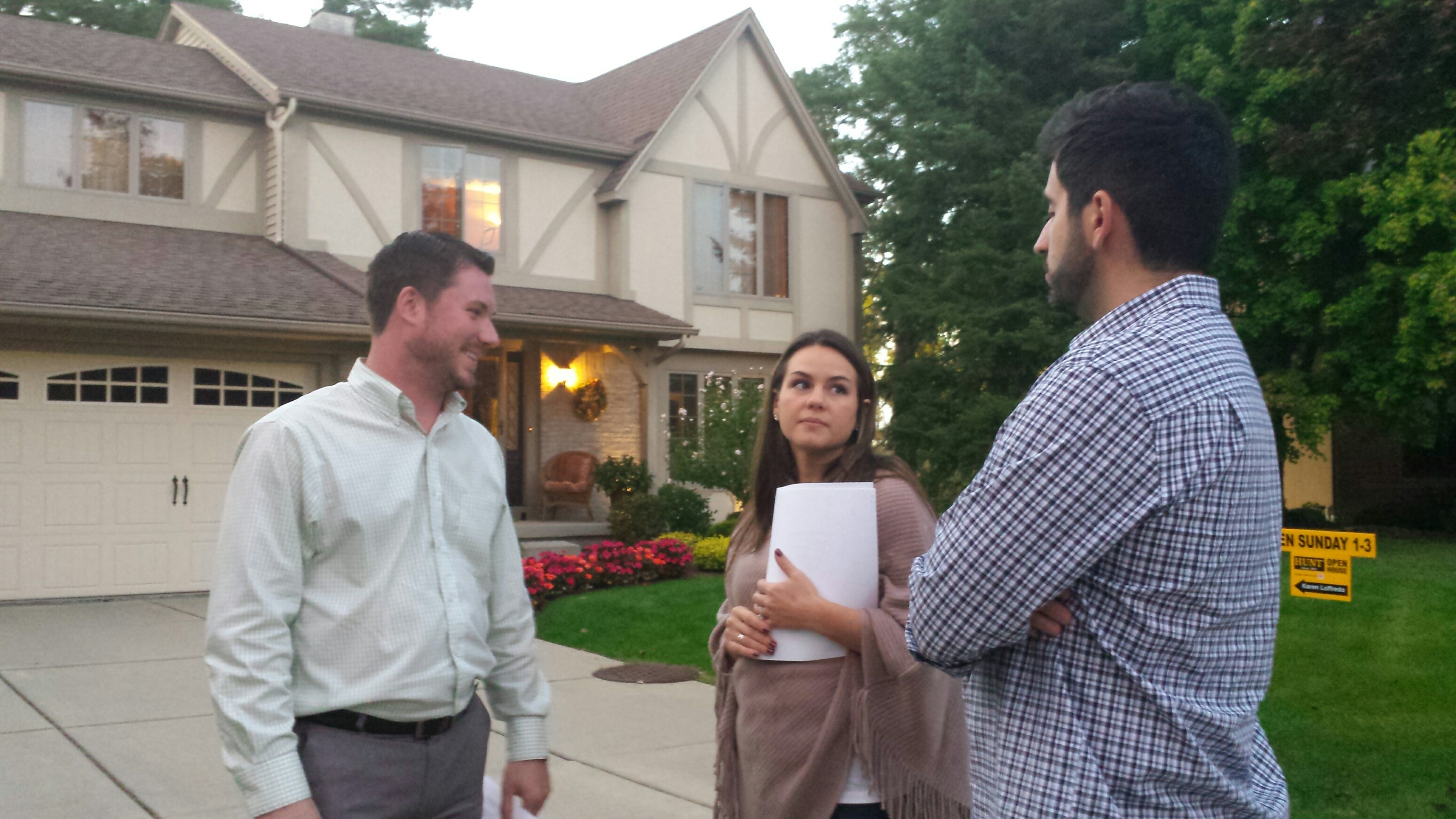 Realtor Greg Straus talks with Micaela and Aaron LaJoie after touring an Amherst home. The home is listed for $289,900, but already has offers over $300,000. (Jonathan D. Epstein/Buffalo News)