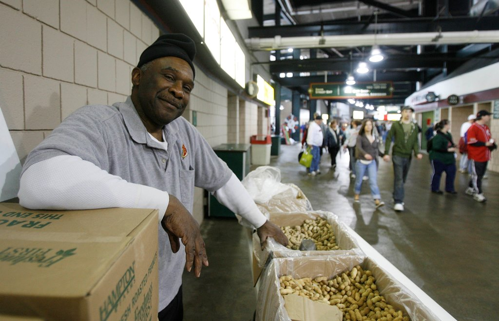 Larry Owens serves up some salted peanuts to customers before the start of the Toledo/Bisons game at what was then known as Dunn Tire Park in, 2008. (Mark Mulville/Buffalo News)