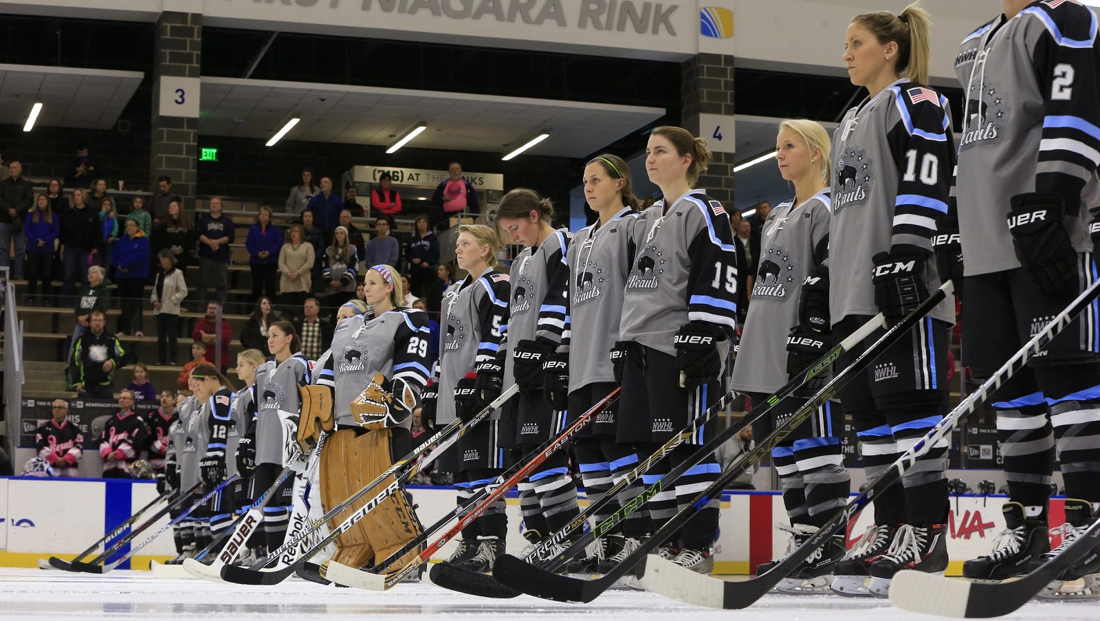 The Buffalo Beauts stand for the national anthem before a 2015 clash against the Boston Pride. (Harry Scull Jr./Buffalo News file photo)