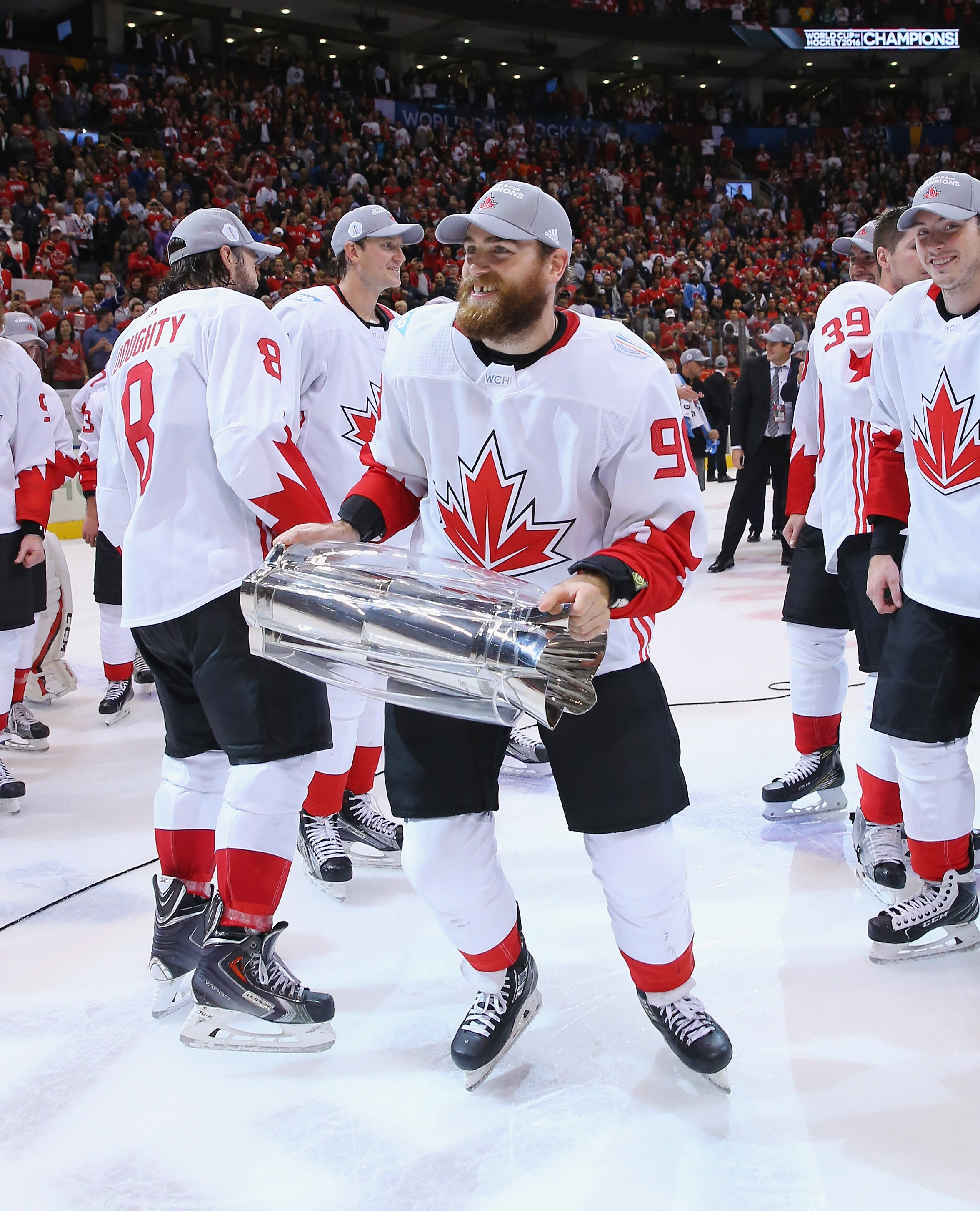 Team Canada's Ryan O'Reilly carries the World Cup of Hockey Trophy after Europe's defeat.