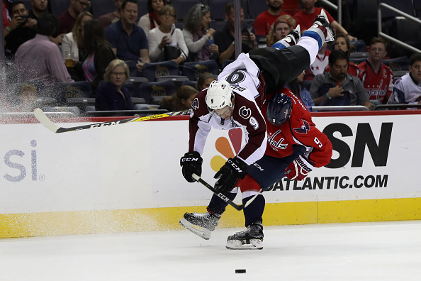 Washington's Dmitry Orlov sends Colorado's Matt Duchene head over heels with a crunching hip check on Tuesday. (Getty Images).