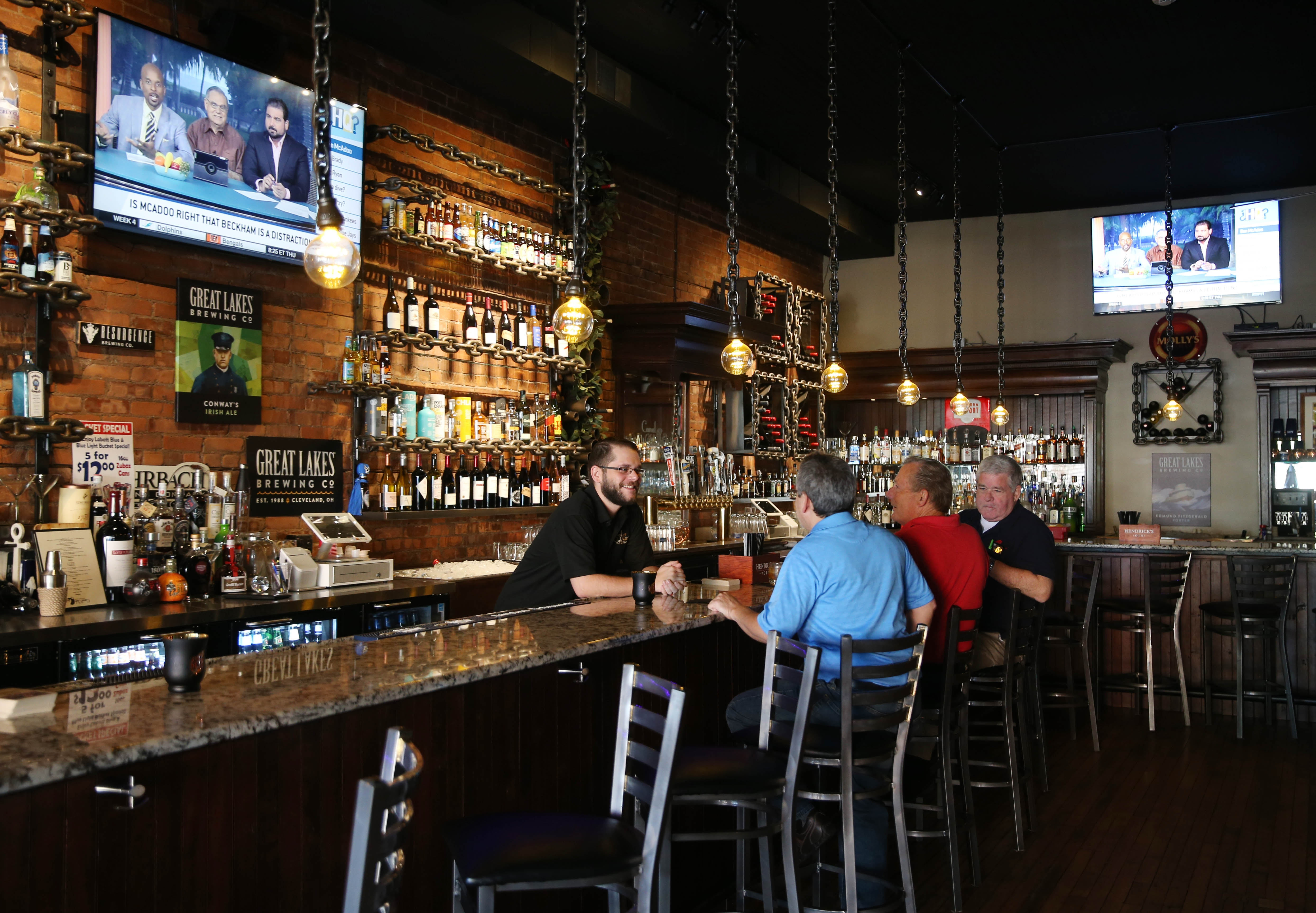 Canal Club 62 Tap and Eatery Restaurant opened at 62 Webster Street in North Tonawanda in March.   Bartender Sean Lasky serves customers.  Photo taken, Tuesday, Sept. 27, 2016.  (Sharon Cantillon/Buffalo News)