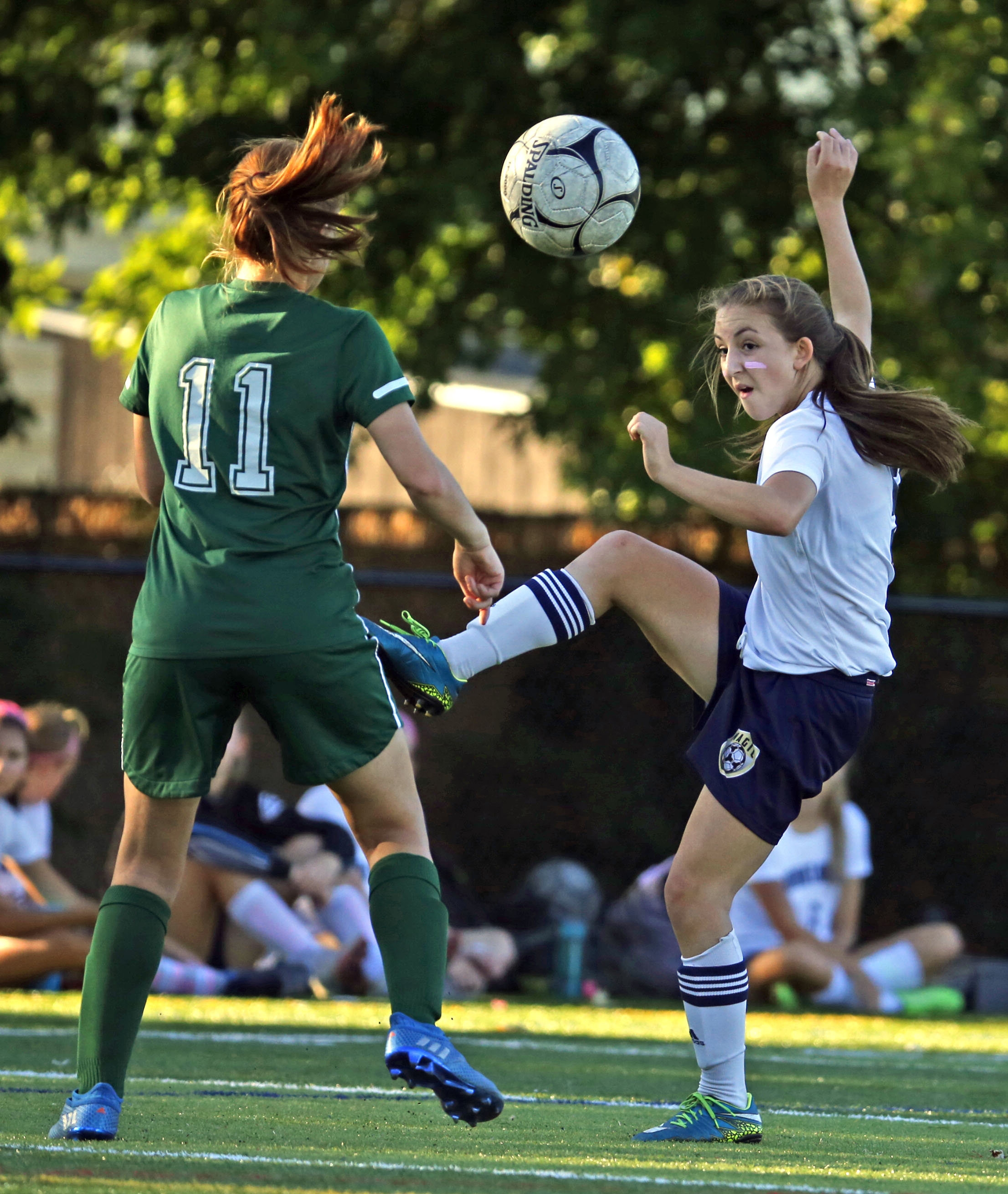Mount Mercy's Mariah Rullan kicks a ball past Nichols Eliza Roach during first half action at Mulroy park on Friday,Oct. 7, 2016.(Harry Scull Jr./Buffalo News)