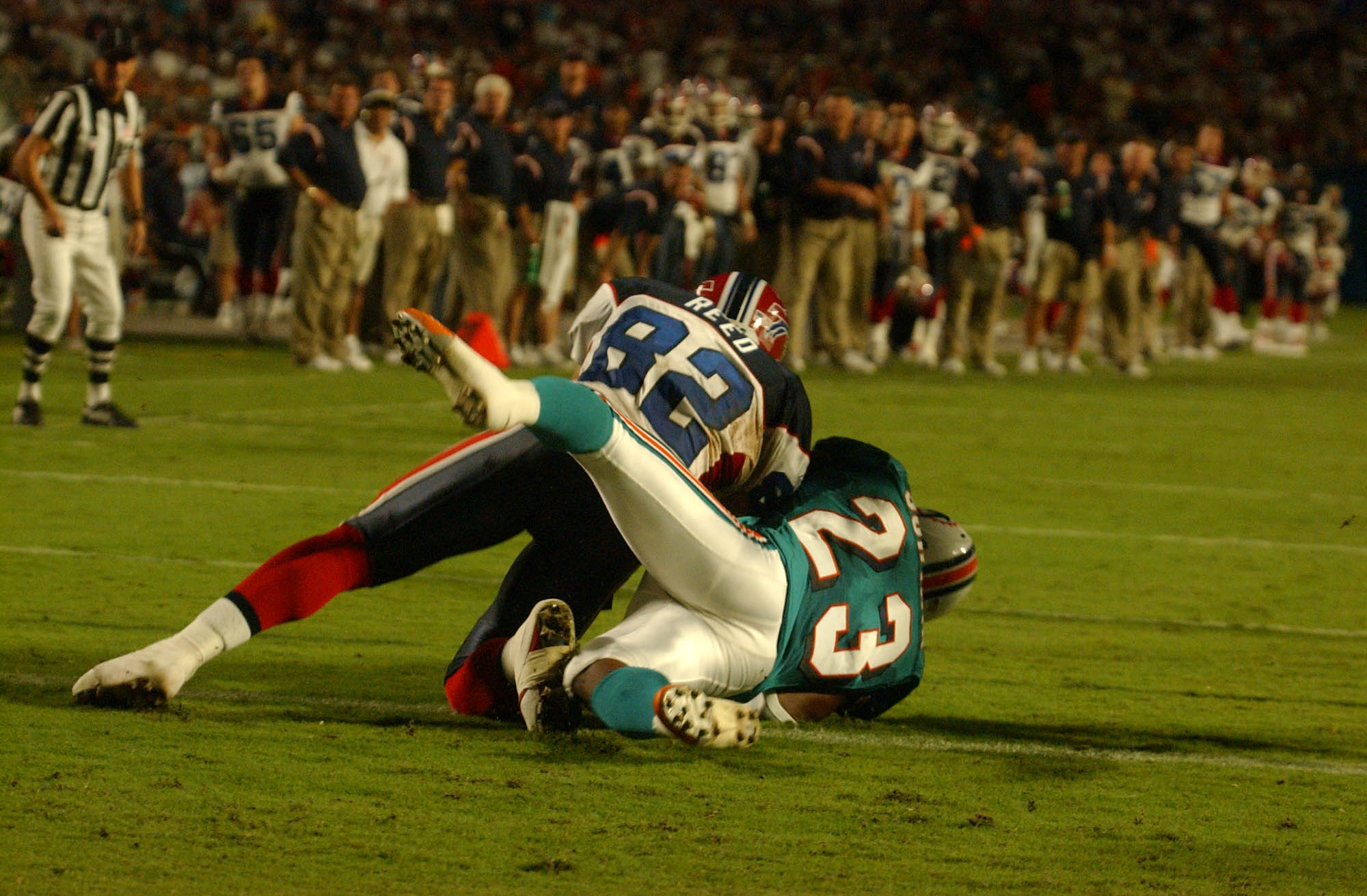 Patrick Surtain comes down with an interception of Travis Henry's trick-play pass in the second quarter of the Bills' 2002 loss in Miami. (James P McCoy/Buffalo News)
