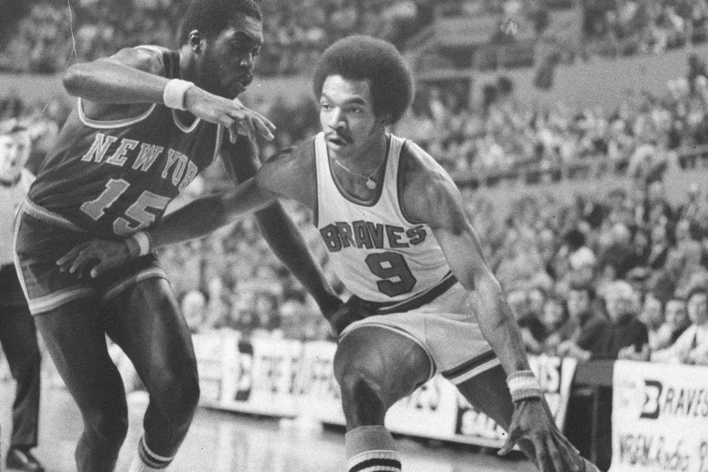 Buffalo's pro hoops team debuted Oct. 14, 1970. Here, Buffalo Braves' Randy Smith drives to the basket past Earl Monroe of the New York Knicks in a January 24, 1975 game in Memorial Auditorium. (News file photo)