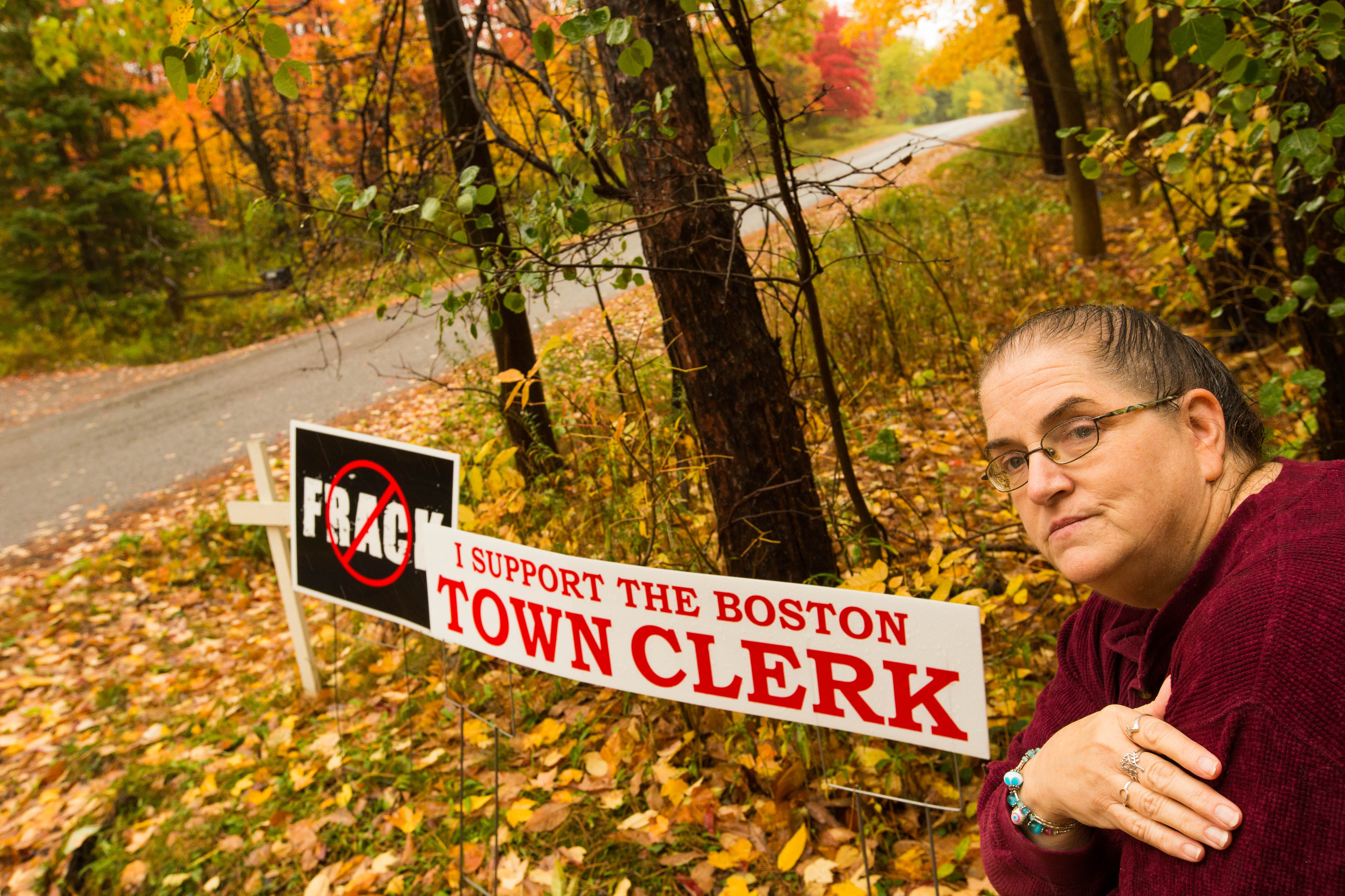 After she posted a sign supporting the Boston town clerk on her property, Barbara Moore received a summons from the Town of Boston ordering her to appear in court for violating the town's temporary sign ordinance.  She says she was not required to pay the $10 fee for her 'No fracking' sign. (Derek Gee/Buffalo News)