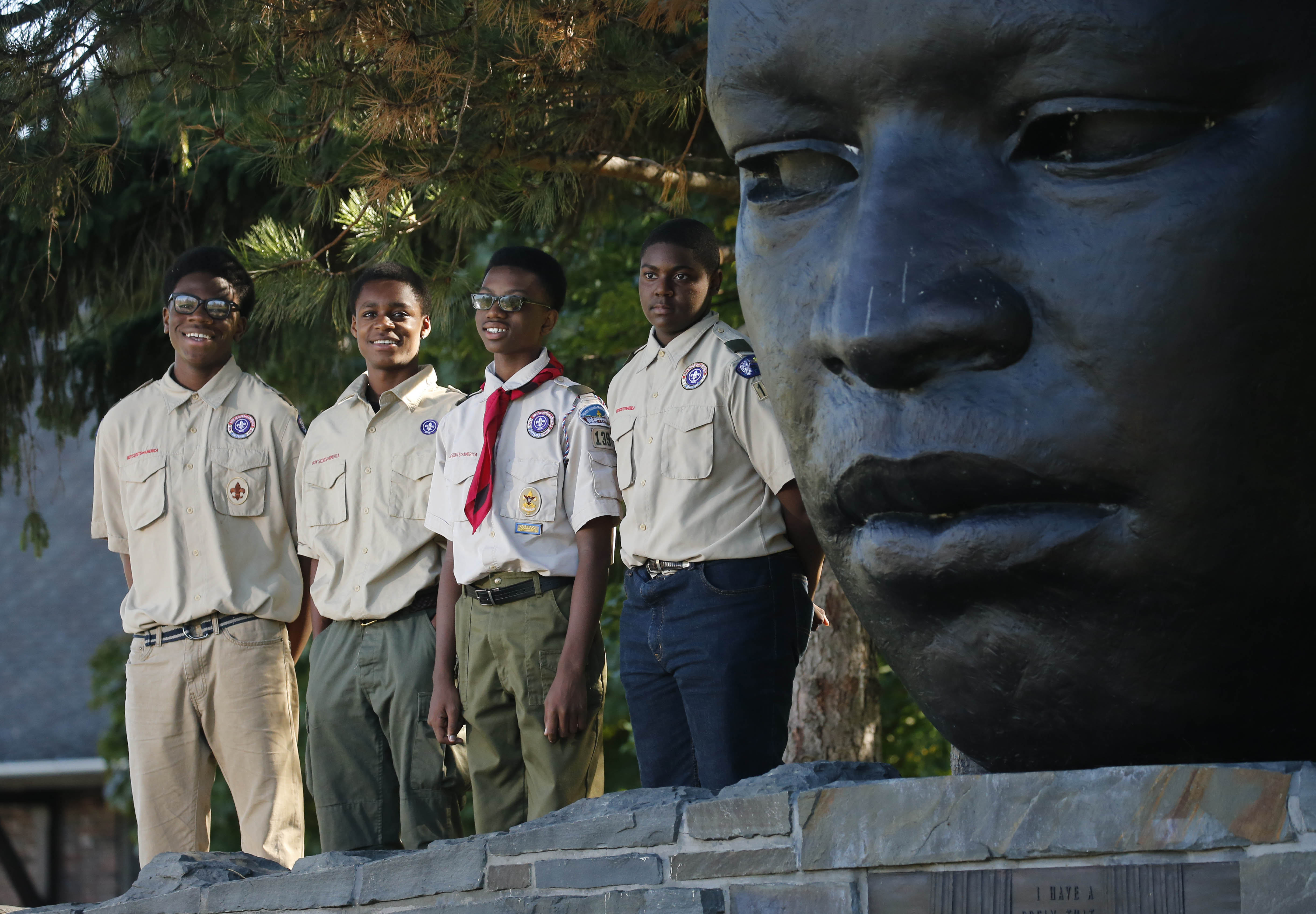 Boy Scouts, from left, Emmanuel Trueheart, 15, Ramon Winfrey, 17, Dekari Jackson, 13, and Jeffrey McMillan, 14, hiked from Niagara Falls to Martin Luther King Park in Buffalo to raise awareness about diabetes while working on a merit badge en route to become Eagle Scouts, Monday, Oct. 10, 2016.  (Derek Gee/Buffalo News)