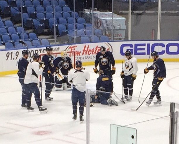 The Sabres gather around Jack Eichel, down on the ice after a practice injury. (John Vogl/Buffalo News)