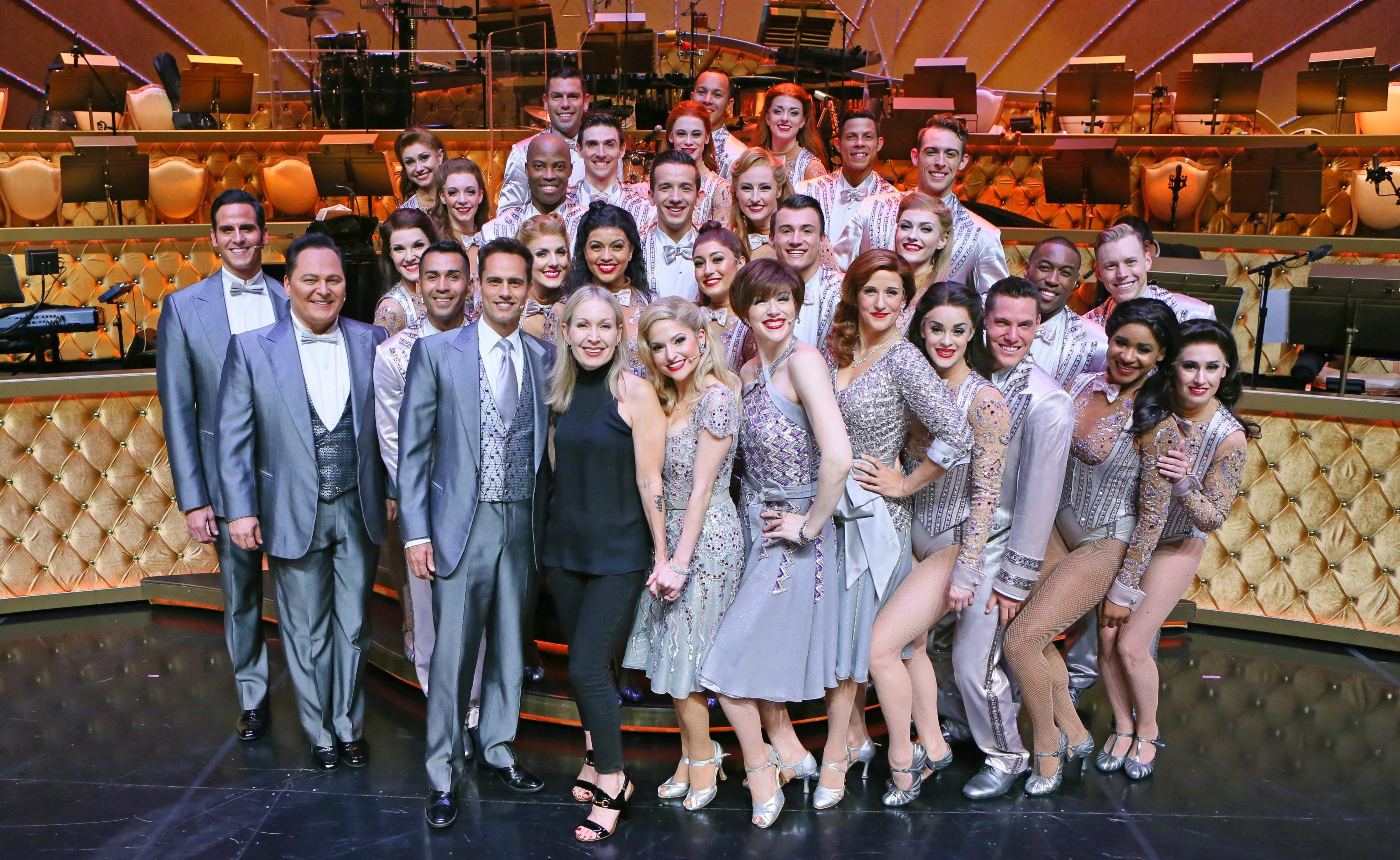 "Accomplished choreographer and Buffalo native Marguerite Derricks, front left, stands with the cast of ""ShowStoppers"" after a performance at Wynn hotel-casino in June in Las Vegas. (Ronda Churchill/Special to The News)"