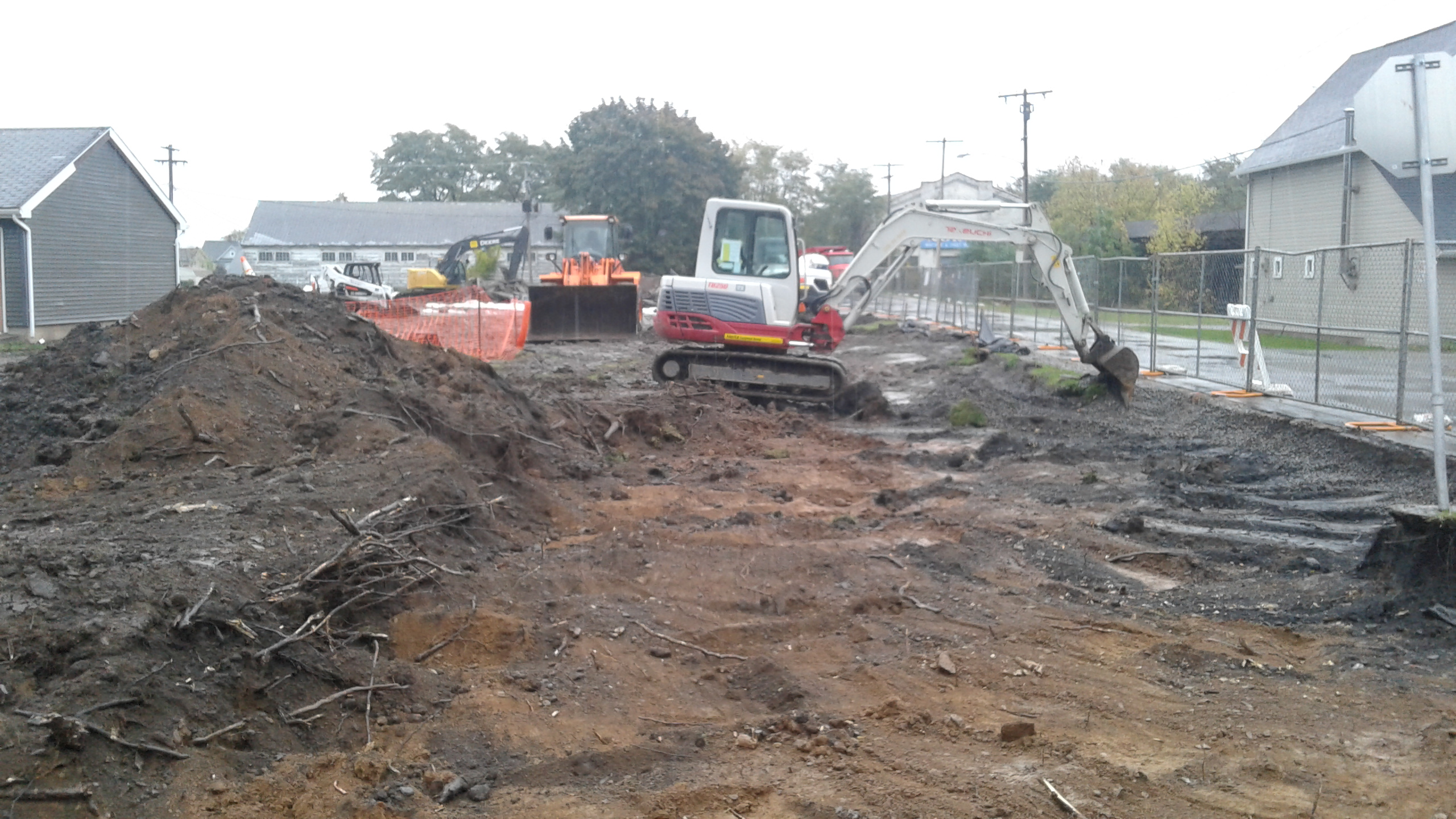 A backhoe excavates soil on Thursday, Oct. 27, 2016 in Middleport, N.Y., where the state has imposed a plan requiring FMC Corp. pay to remove arsenic-contaminated soil from outside more than 200 properties.  (Thomas J. Prohaska / The Buffalo News)