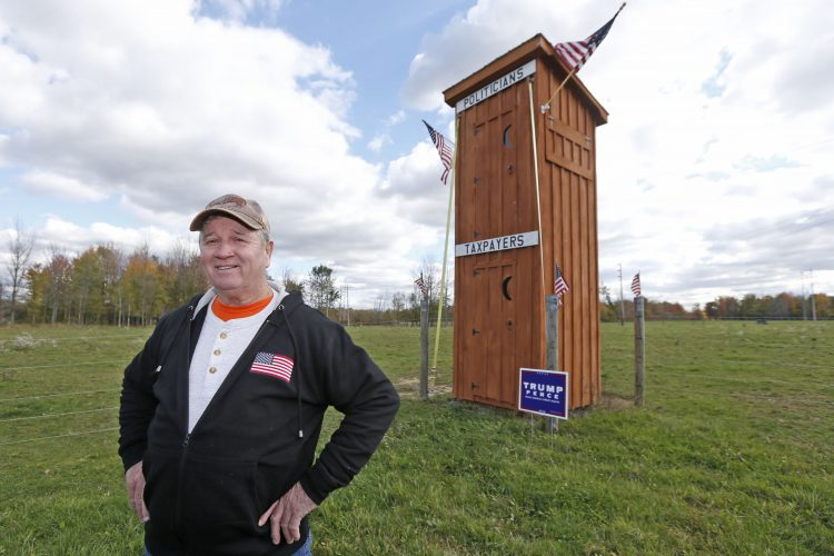 Farmer who thinks politicians are full of manure erects politically incorrect outhouse