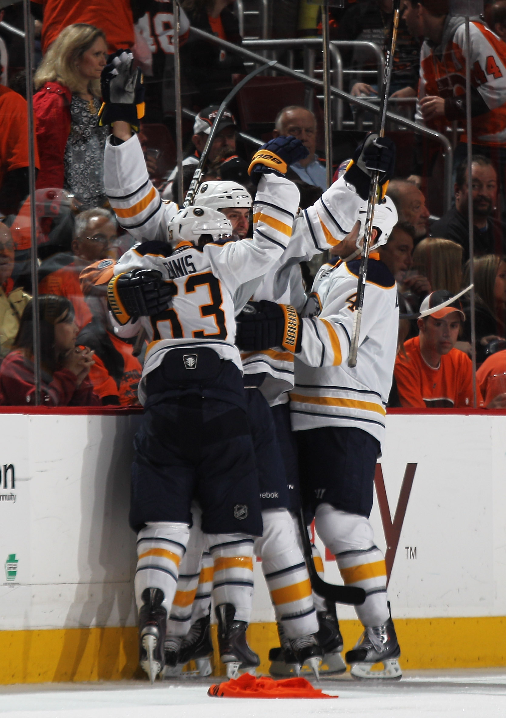 PHILADELPHIA, PA - APRIL 22: Tyler Ennis #63 of the Buffalo Sabres celebrates with teammates after scoring the game winning goal in overtime in Game Five of the Eastern Conference Quarterfinals during the 2011 NHL Stanley Cup Playoffs at Wells Fargo Center on April 22, 2011 in Philadelphia, Pennsylvania. The Buffalo Sabres defeated the Philadelphia Flyers 4 to 3. (Photo by Bruce Bennett/Getty Images)