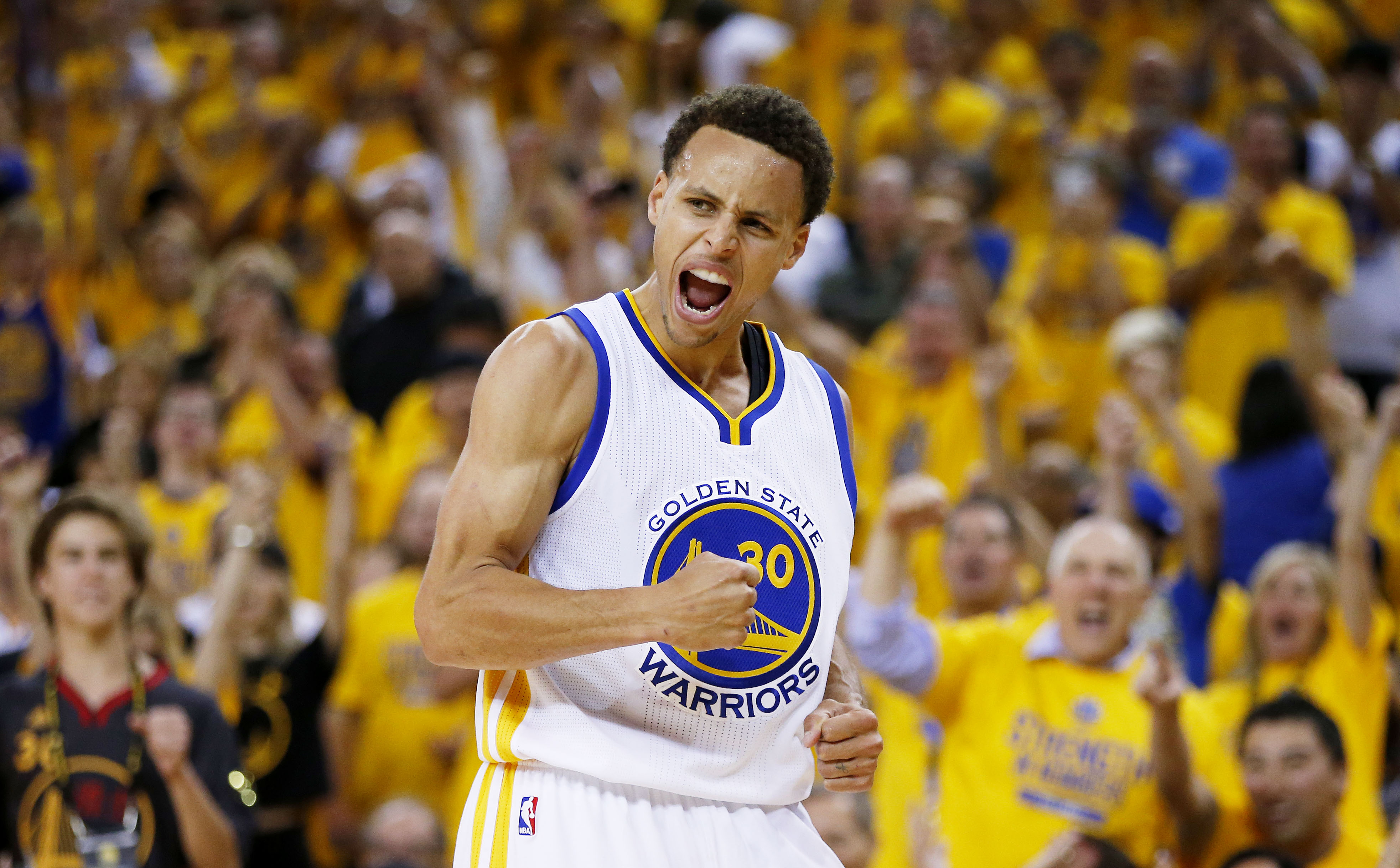 OAKLAND, CA - JUNE 14: Stephen Curry #30 of the Golden State Warriors celebrates in the second quarter against the Cleveland Cavaliers during Game Five of the 2015 NBA Finals at ORACLE Arena on June 14, 2015 in Oakland, California. NOTE TO USER: User expressly acknowledges and agrees that, by downloading and or using this photograph, user is consenting to the terms and conditions of Getty Images License Agreement. (Photo by Ezra Shaw/Getty Images)