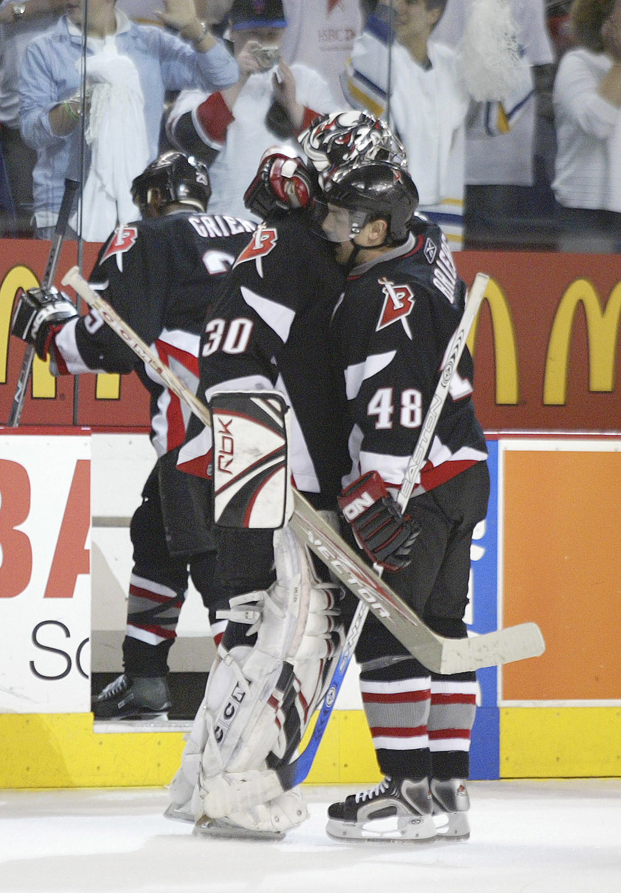 BUFFALO, NY- APRIL 22: Daniel Briere #48 of the Buffalo Sabres hugs teammate Ryan Miller #30 after scoring the game-winning goal in the second overtime period against the Philadelphia Flyers in game one of the Eastern Conference Quarterfinals during the 2006 NHL Playoffs on April 22, 2006 at HSBC Arena in Buffalo, New York. The Sabres defeated the Flyers 3-2 in double overtime. (Photo by Rick Stewart/Getty Images)