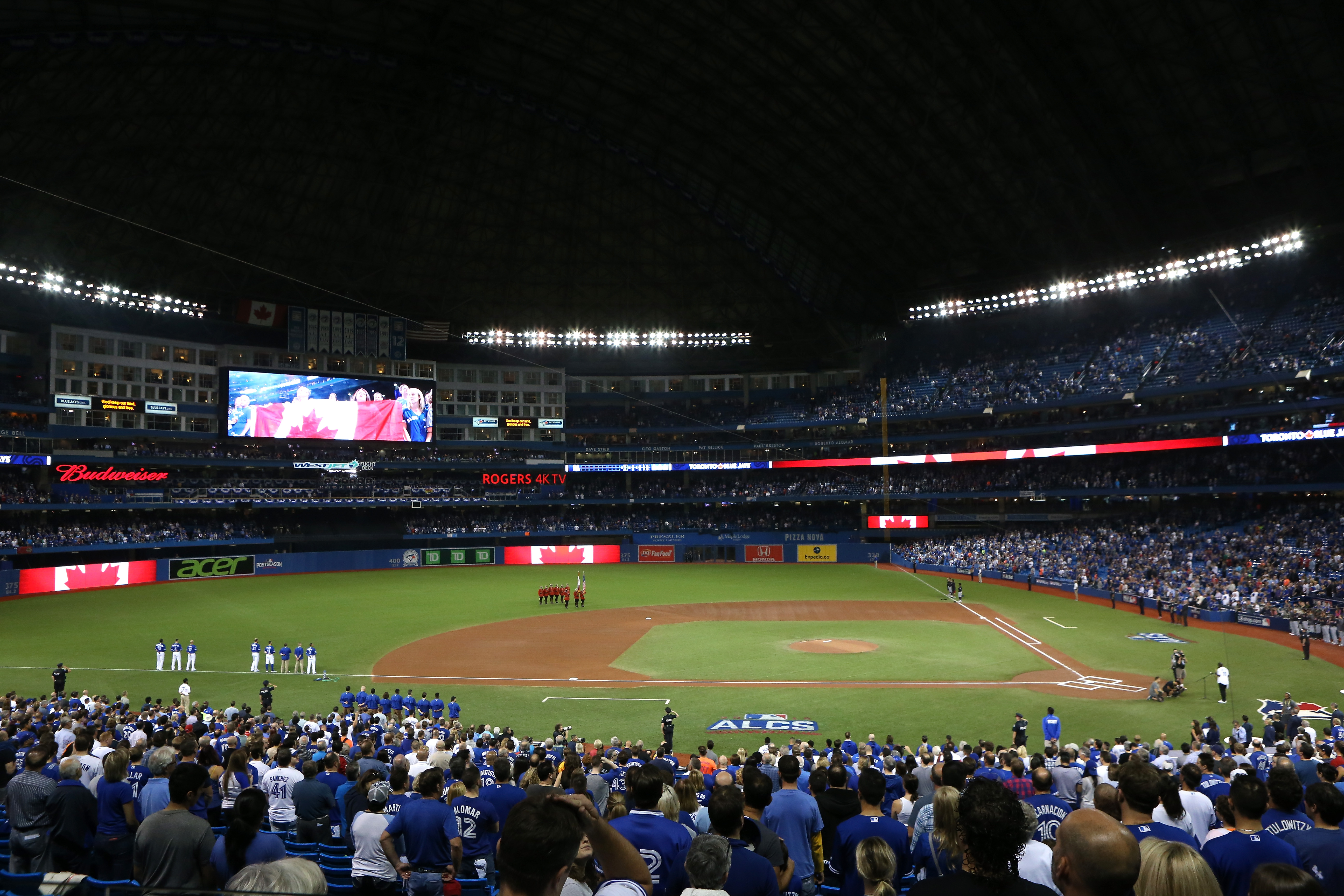 Saxophonist Michael Phillips plays the Canadian national anthem prior to game four of the American League Championship Series between the Toronto Blue Jays and the Cleveland Indians at Rogers Centre.  (Getty Images)