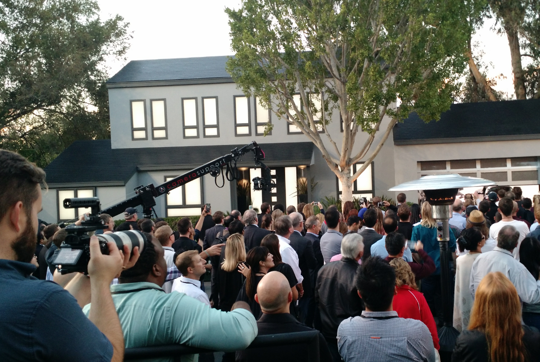 Elon Musk shows off new solar roof designs, using the movie-set homes from 'Desperate Housewives' TV show Friday evening. (David Robinson/Buffalo News)