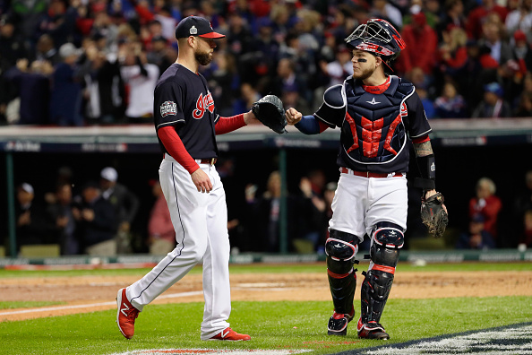 Corey Kluber and catcher Roberto Perez celebrate another quick inning for the Indians against the Cubs (Getty Images).