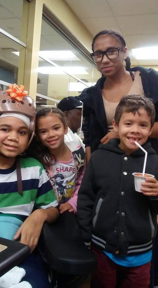 Juan Rodriguez with family members n the hospital. (Photo from family)