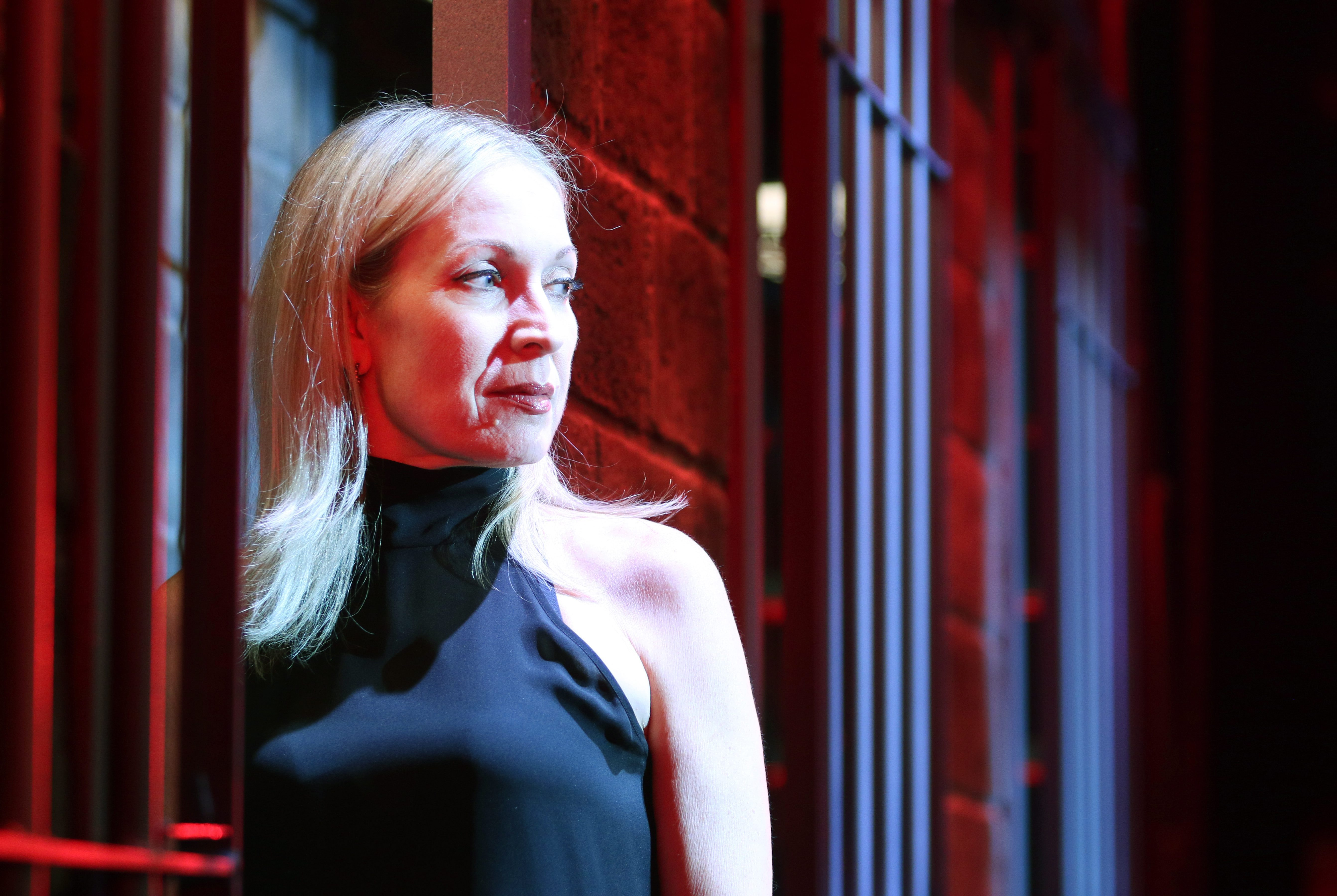 "Accomplished choreographer and Buffalo native Marguerite Derricks stands inside a set design from Cell Block Tango (from ""Chicago"") after a performance of ShowStoppers at Wynn hotel-casino in Las Vegas. (Ronda Churchill/for The Buffalo News)"