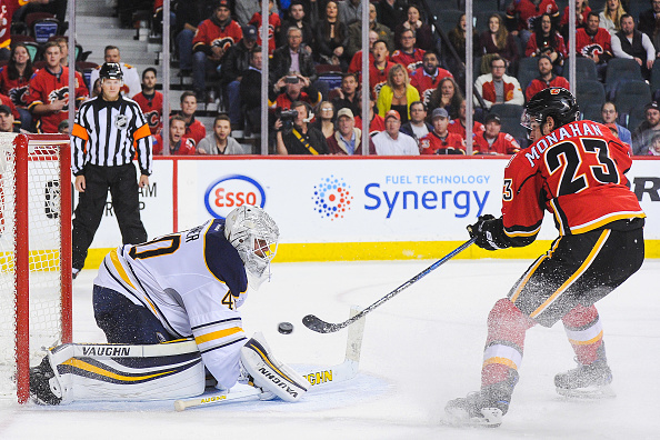 Calgary's Sean Monahan beats Sabres goalie Robin Lehner for the game-winning goal in overtime (Getty Images).