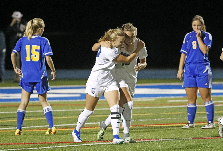 Pezzino meets up with teammate Marcy Barberic, who assisted on the record-setting goal.