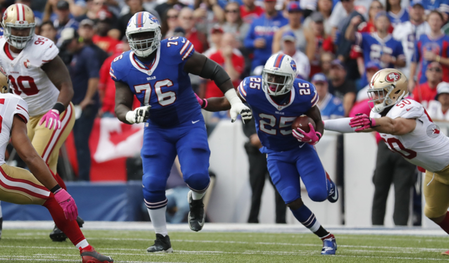 John Miller, leading the way for LeSean McCoy, was able to keep his starting spot at right guard for the Bills. (Harry Scull Jr./Buffalo News)