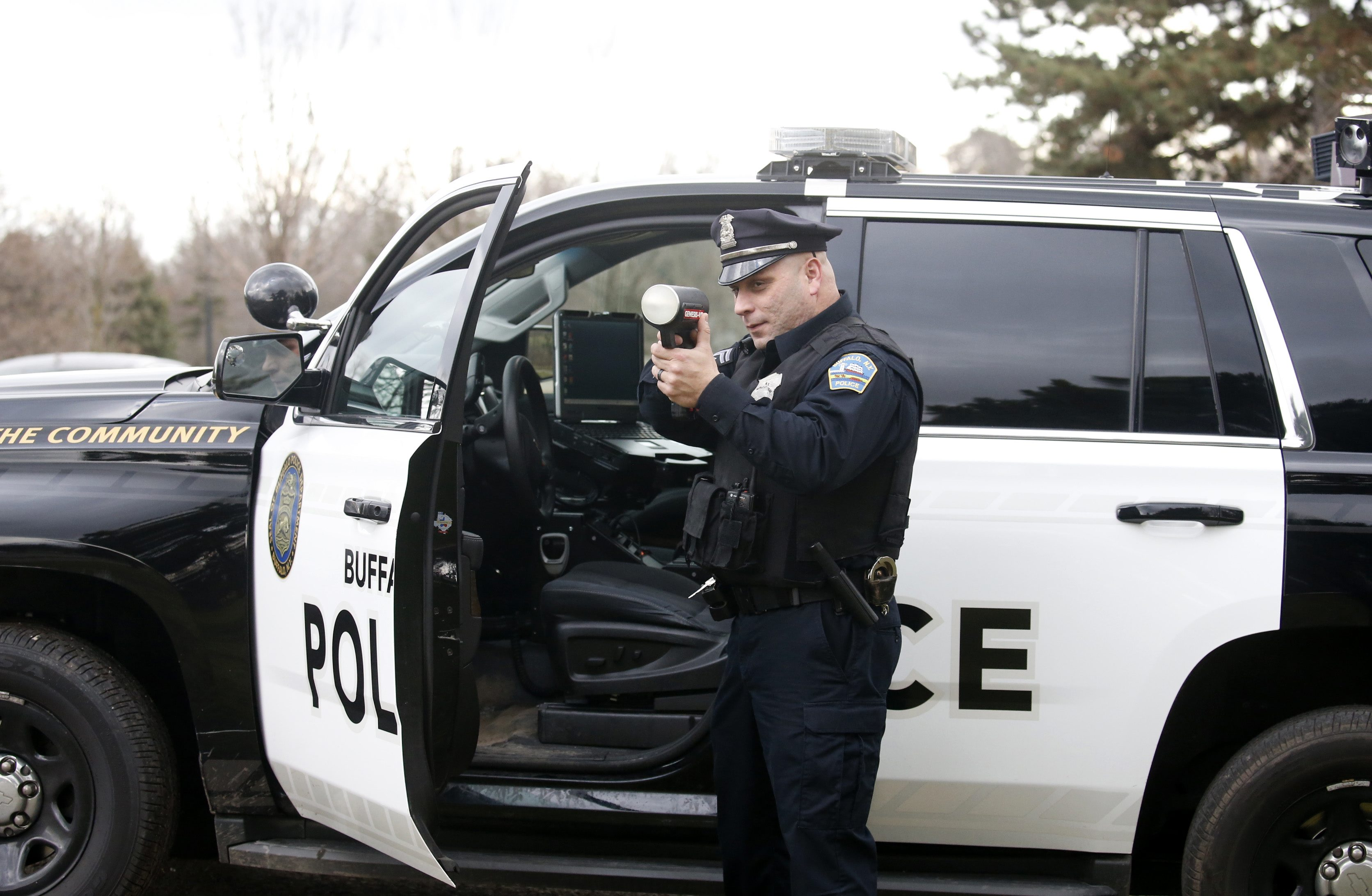 Buffalo police Officer Obed Casillas aims a radar to catch speeders in the 'S-Curves' section of Delaware Avenue on Wednesday, Feb. 3, 2016.  (Robert Kirkham/Buffalo News)