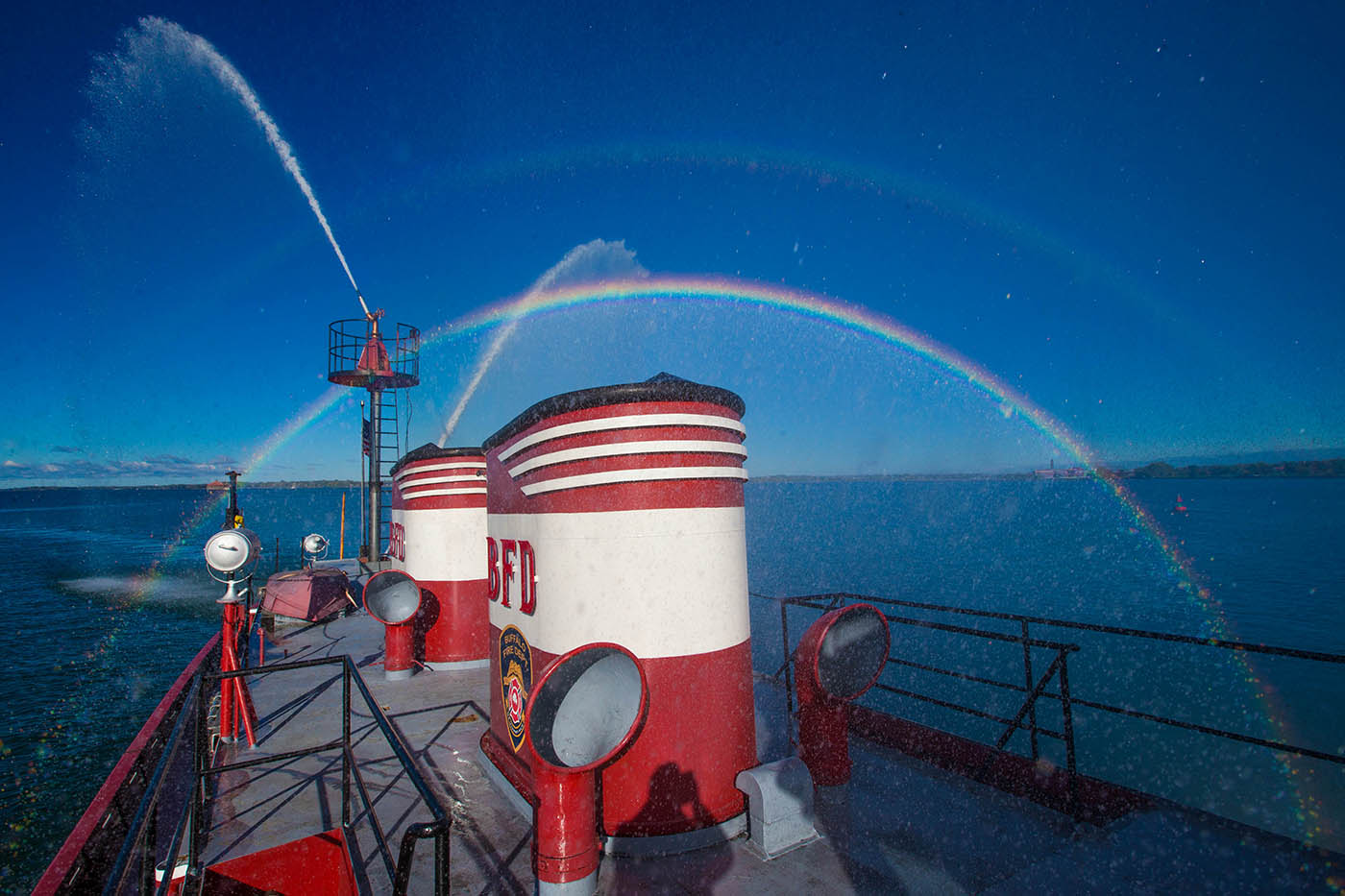 The spray of water cannons in the mornng sun creates rainbows aboard the Edward M. Cotter, Friday morning, Oct. 14, 2016. (Derek Gee/Buffalo News)
