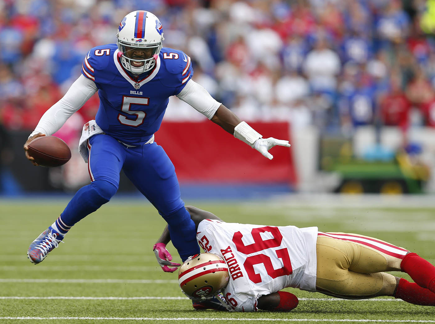 Buffalo Bills quarterback Tyrod Taylor (5) breaks a tackle attempt by San Francisco 49ers cornerback Tramaine Brock (26) during the second quarter at New Era Field in Orchard Park, Sunday, Oct. 16, 2016. (Mark Mulville/The Buffalo News)