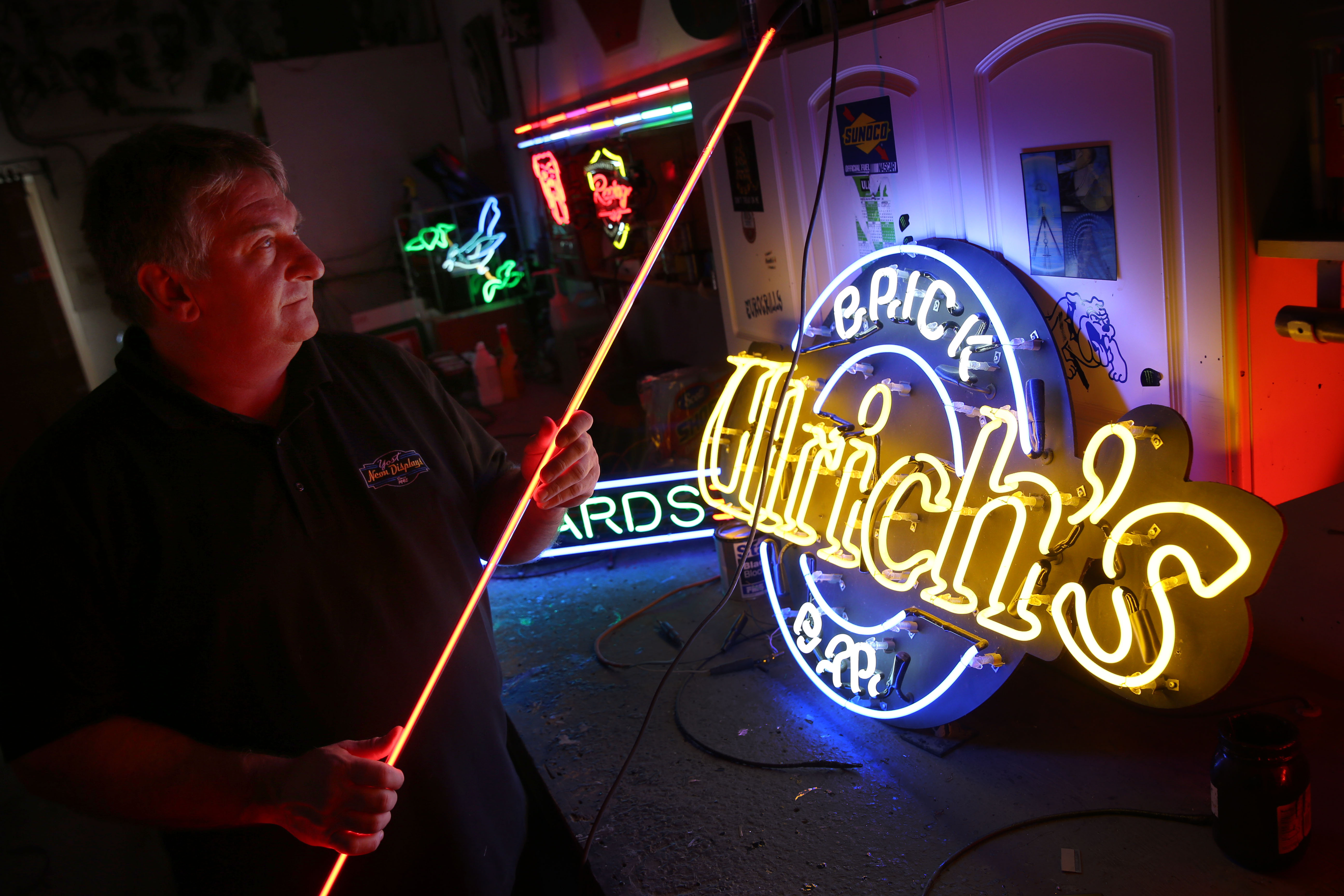 Michael Yost, owner of Yost-Neon Displays is the largest neon maker and the last of the glass benders in WNY.  Though neon signs are still used, it is on the decline being replaced by LED's. He's in his shop in West Seneca, Wednesday, Oct. 19, 2016.  .  (Sharon Cantillon/Buffalo News)