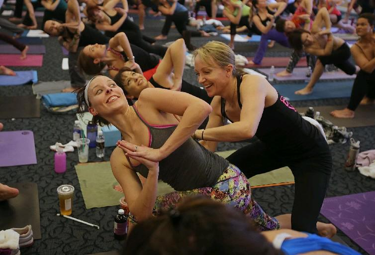 Catherine Cook-Cottone, right, helps lead free yoga classes Wednesdays and Saturdays at Resurrection Church Community Room, 3 Doat St., at Genesee St.  (Buffalo News file photo)