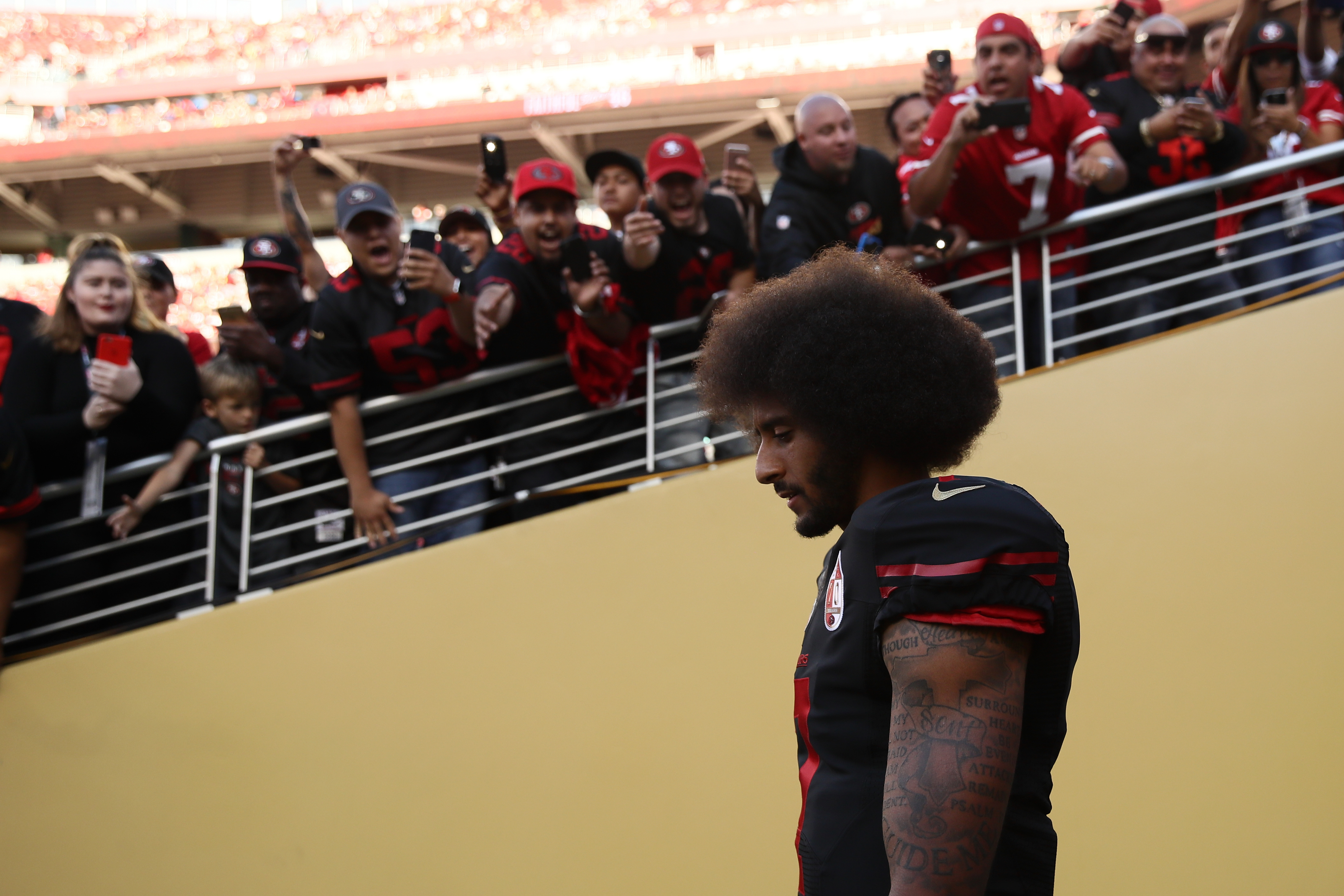 Fans have not always been open to listening to Colin Kaepernicks message about social injustice, but his protests during the national anthem have prompted a national conversation.   (Getty Images)