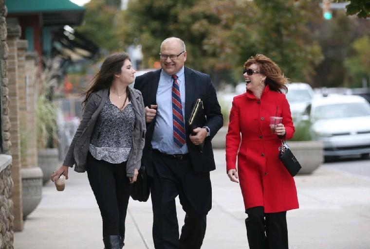 From left, Iliana, Dan and Kelsey Lukasiak enjoy a walk along Elmwood Avenue in Buffalo earlier this week.