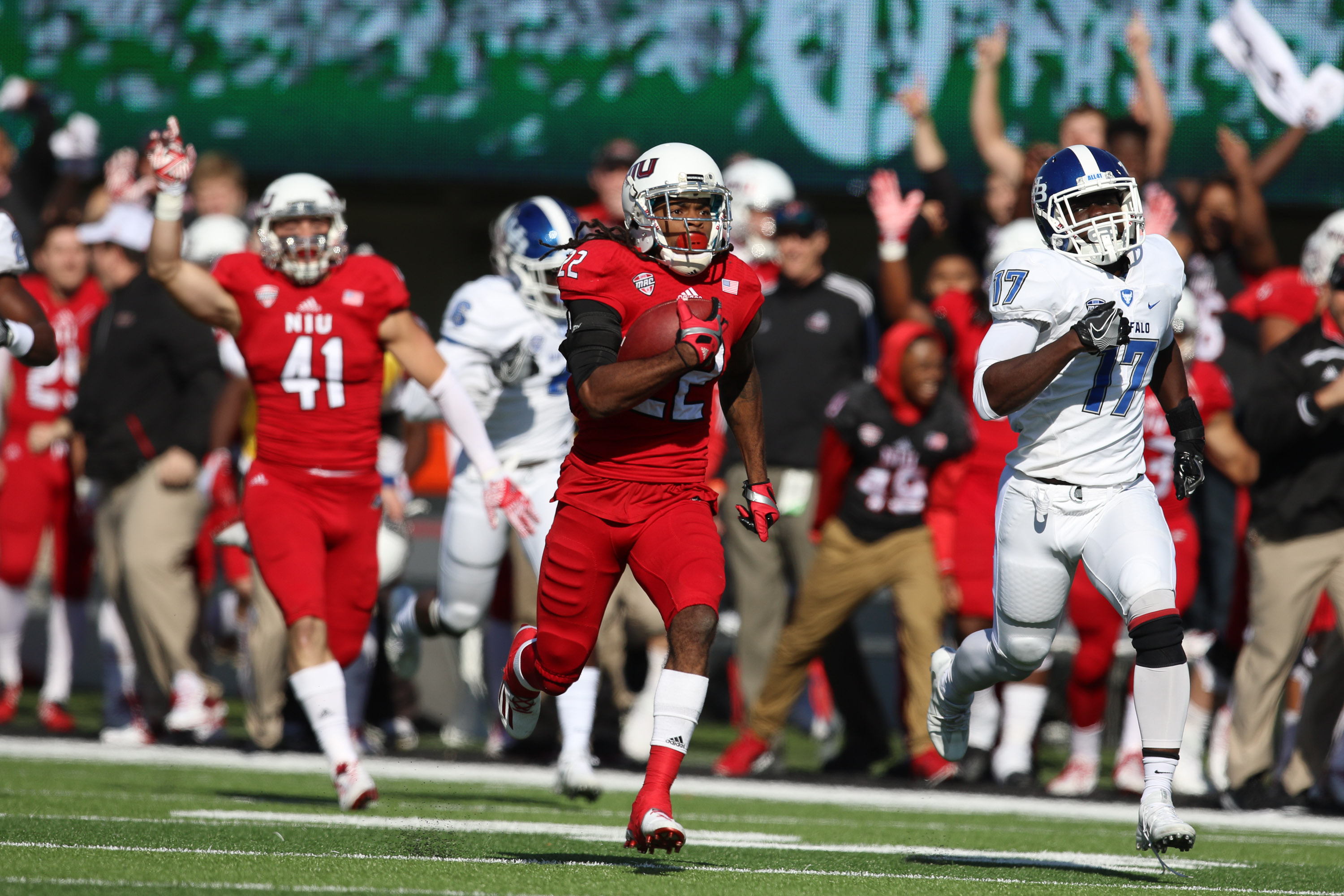 Northern Illinois wide receiver Aregeros Turner  returns the opening  kickoff for a touchdown.