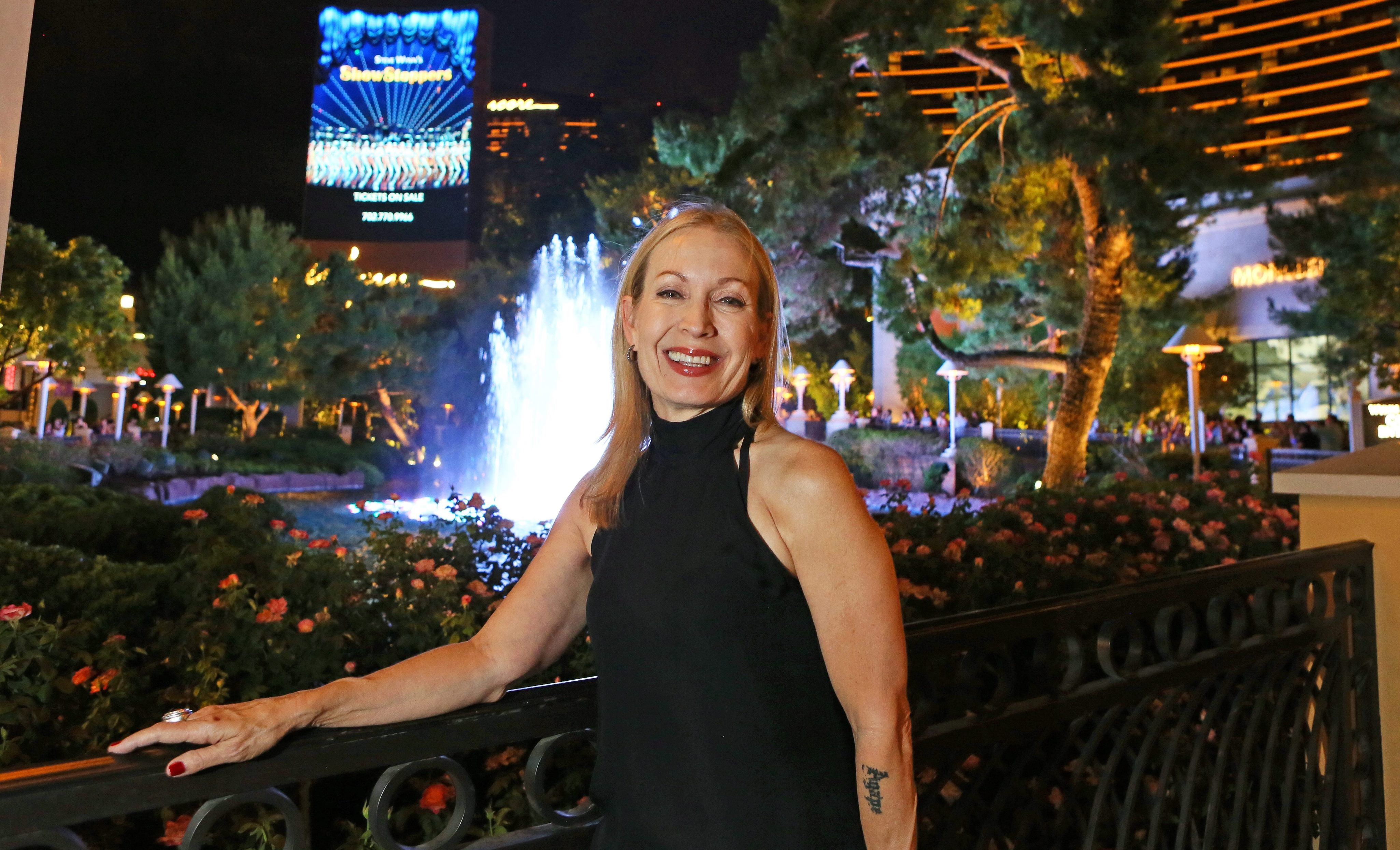 """Buffalo native Marguerite Derricks is photographed outside the Wynn hotel-casino in Las Vegas, where she is the choreographer for Wynn's musical production """"ShowStoppers."""" (Ronda Churchill/Special to The News)"""