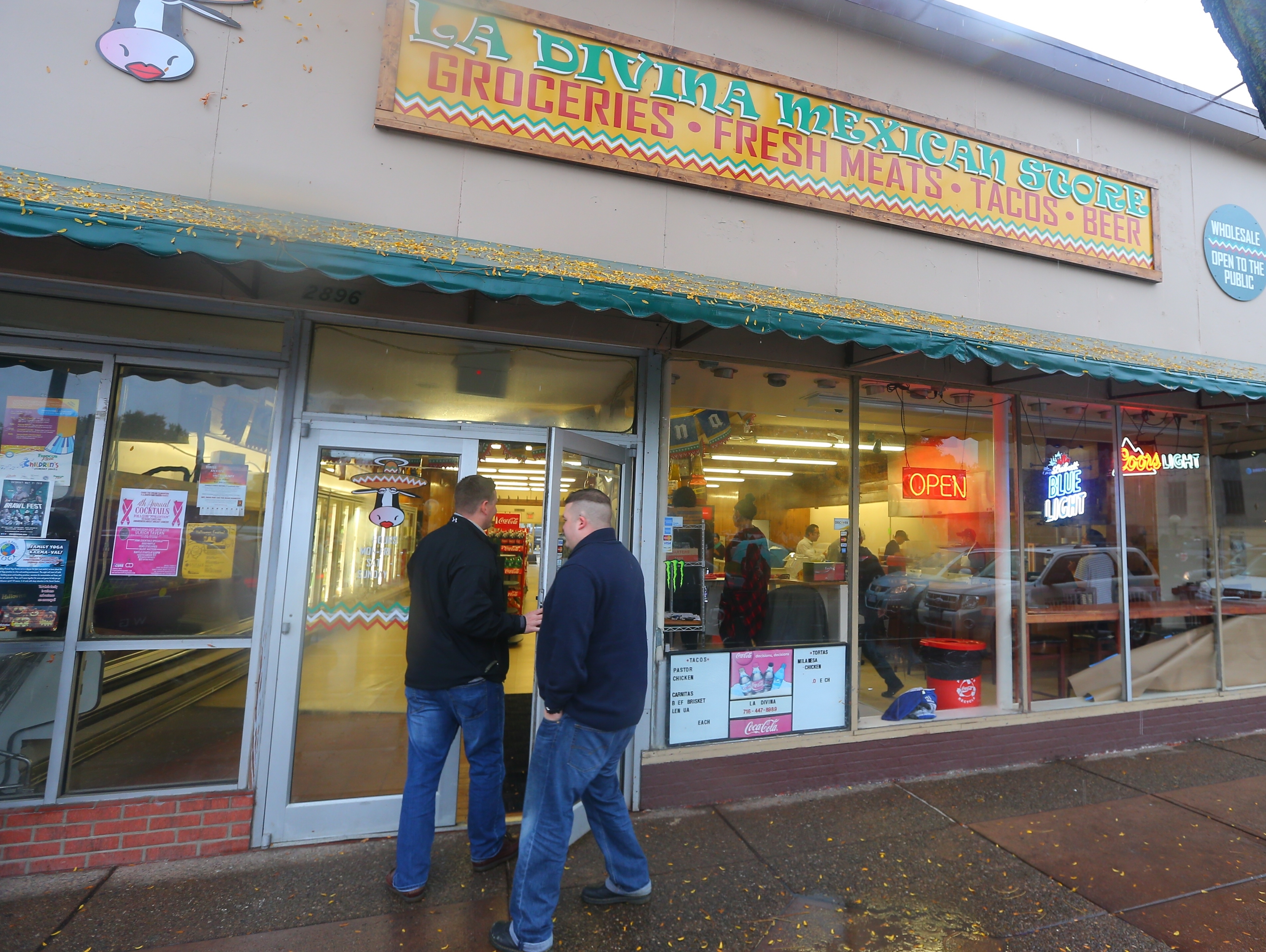 Patrons arrive after Sergio Mucino, owner, reopened La Divina Mexican Store  on Friday, Oct. 21, 2016, in Kenmore after briefly closing following a raid by federal agents, where he was arrested along with several employees earlier this week.  (John Hickey/Buffalo News)