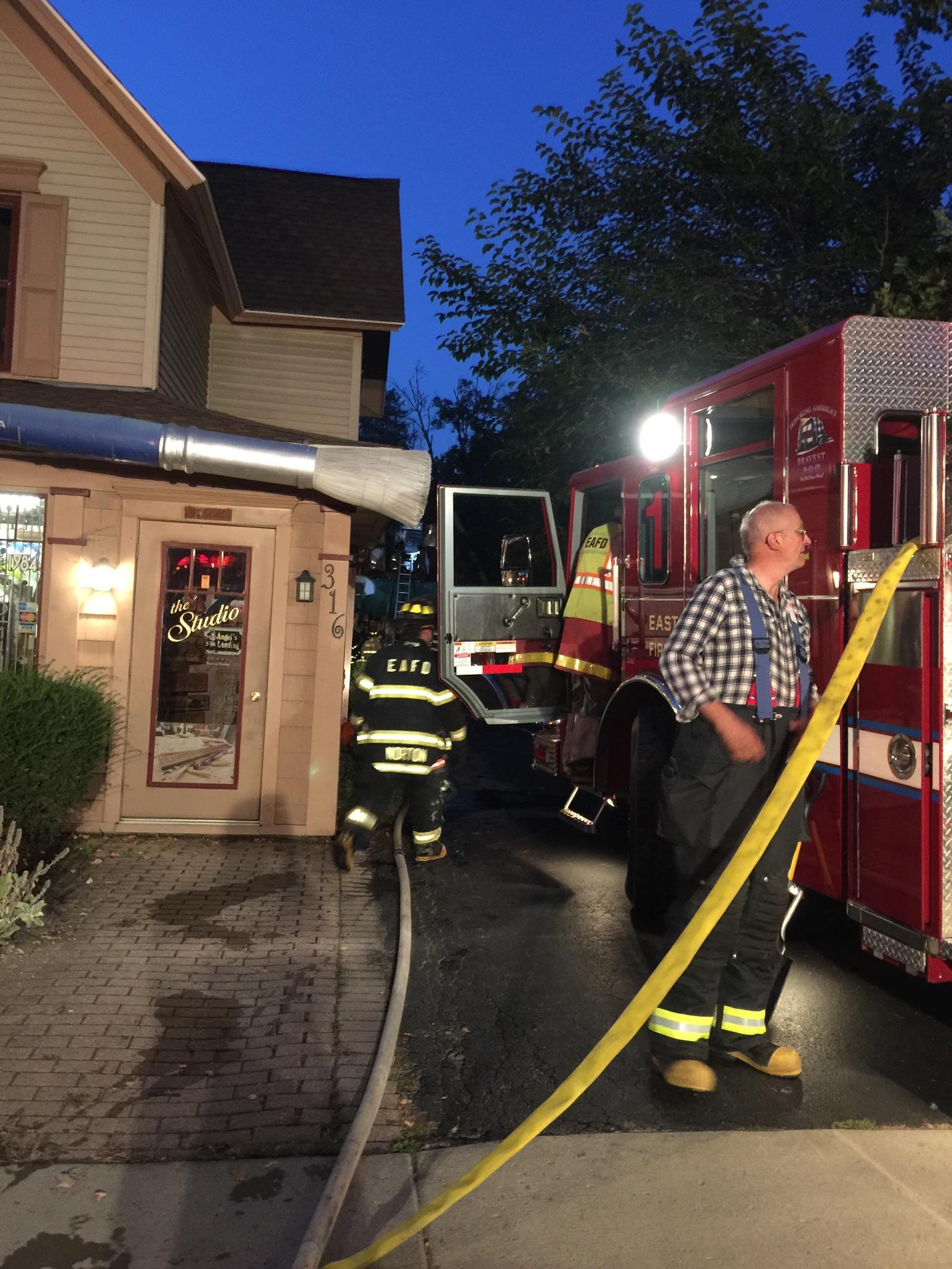 Firefighters battle a blaze at an East Aurora sign shop. (Matt Gryta/Buffalo News)