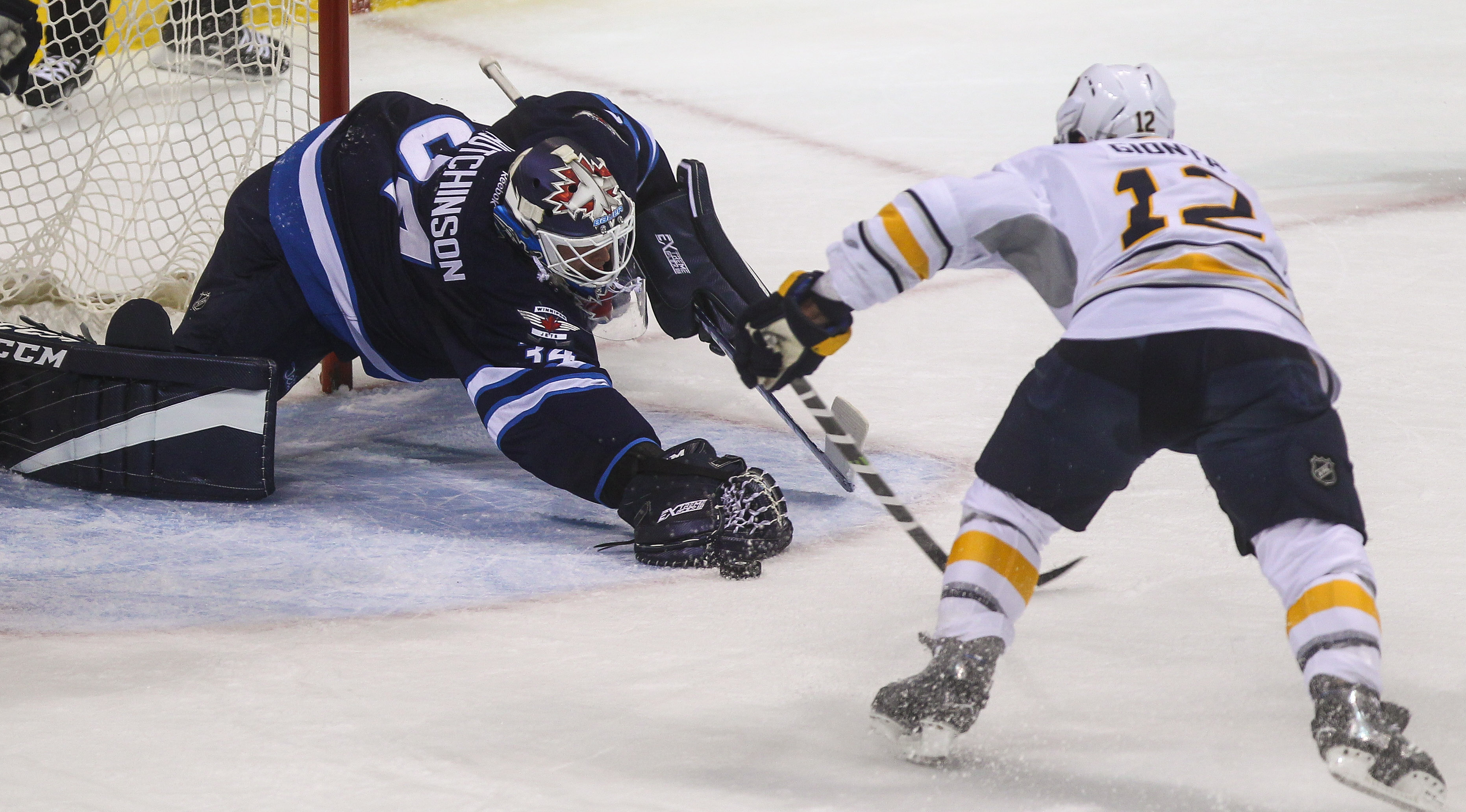 The Sabres' Brian Gionta goes in for the score against Jets goalie Michael Hutchinson. (Mike Deal/Winnipeg Free Press)