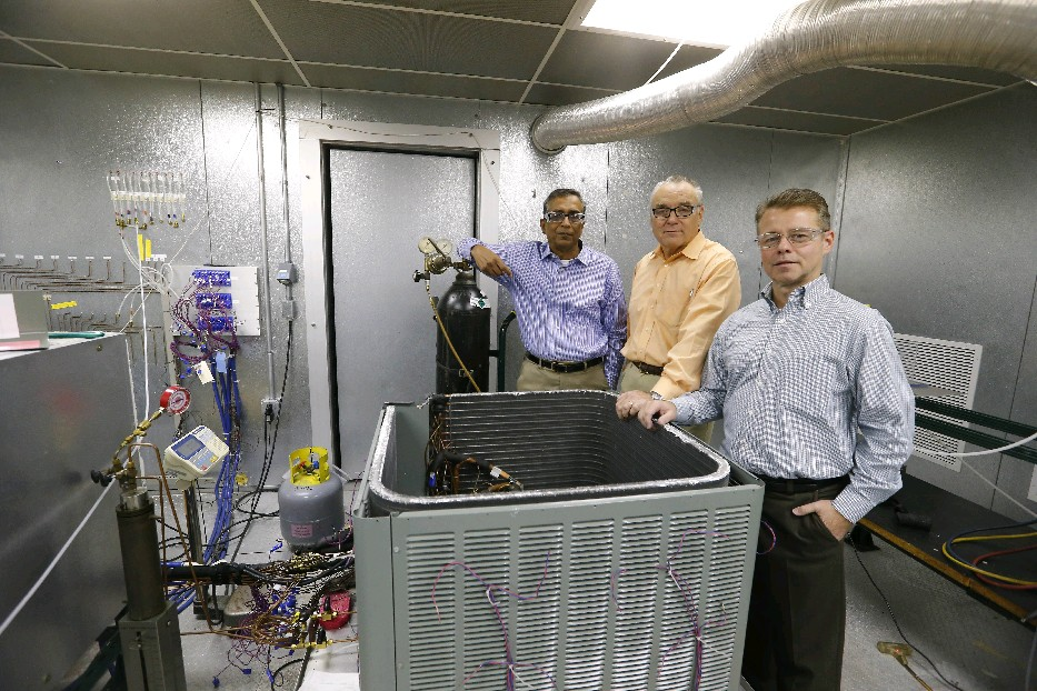 Honeywell's Rajiv R. Singh, a corporate fellow and senior research and development director (left); David J. Williams, director of technology for foam blowing agents (center); and Bob Sikorski, the site leader at the company's Buffalo Research Laboratory (right) are in the Refrigeration Test Chamber at the company's research laboratory on Peabody Street in Buffalo last week. (Mark Mulville/The Buffalo News)