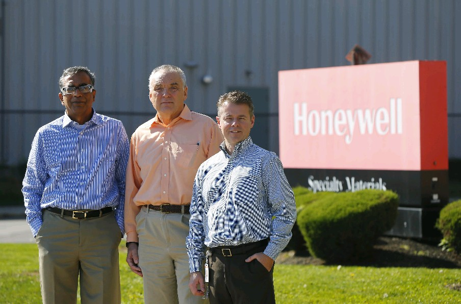 Honeywell's Rajiv R. Singh, corporate Fellow & senior research and development director, (left); David J. Williams, director of technology for foam blowing agents (center); and Bob Sikorski, the site leader at Honeywell's Buffalo Research Laboratory (right) take a moment outside the Peabody Street lab last week. (Mark Mulville/The Buffalo News)