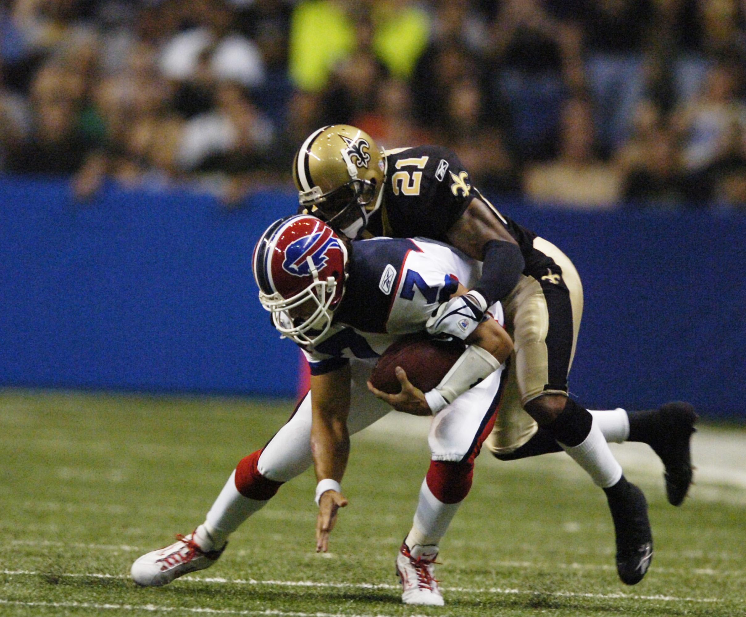Buffalo Bills quarterback J.P. Losman is taken down by New Orleans' Jason Craft in an Oct. 2, 2005 game.  (News file photo/James P. McCoy)