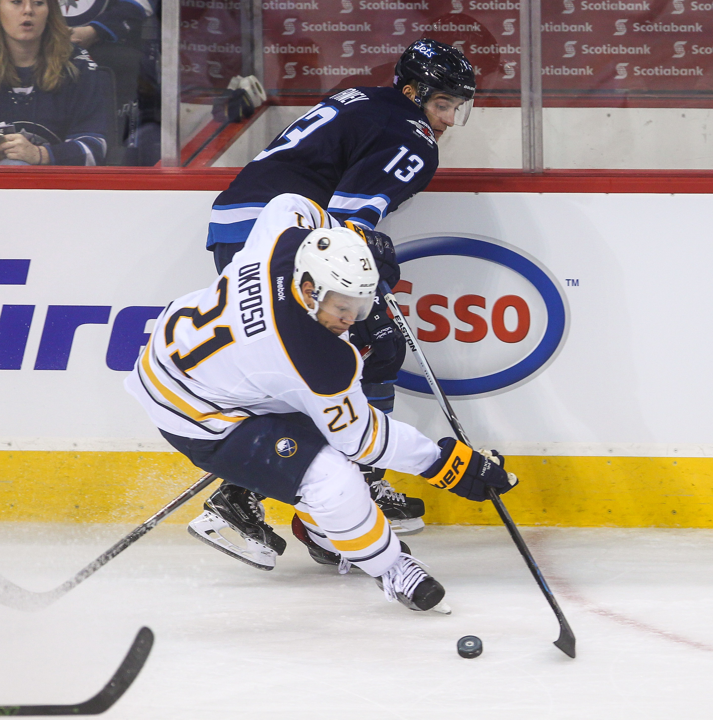Sabres forward Kyle Okposo forces the Jets' Brandon Tanev off the puck. (Mike Deal / Winnipeg Free Press)