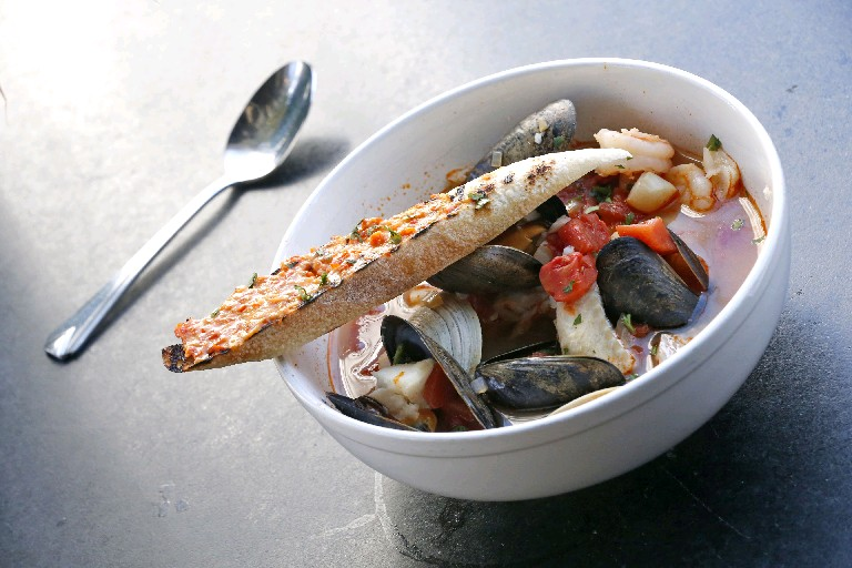 Cioppino is among the healthy meals at Oshun; Carol DeNysschen took half of hers home.