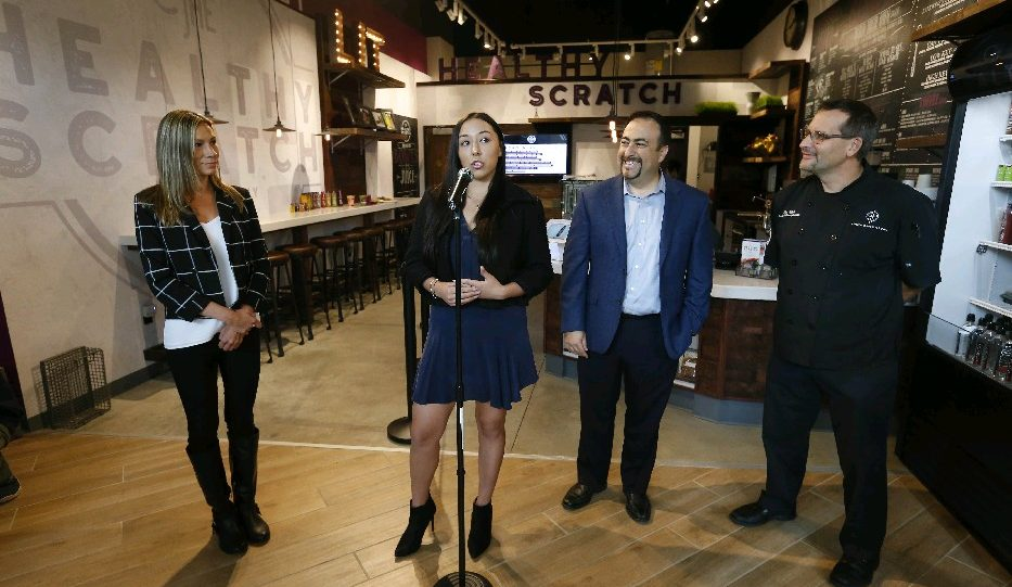 The Healthy Scratch team unveiled the new HarborCenter healthy cafe on Monday. They are, from left, cafe GM Kristina Black, co-owner Kelly Pegula, Dominic Verni, HarborCenter vice president for food and beverages, and Ron Kubiak, director of culinary operations for HarborCenter. (Mark Mulville)/Buffalo News