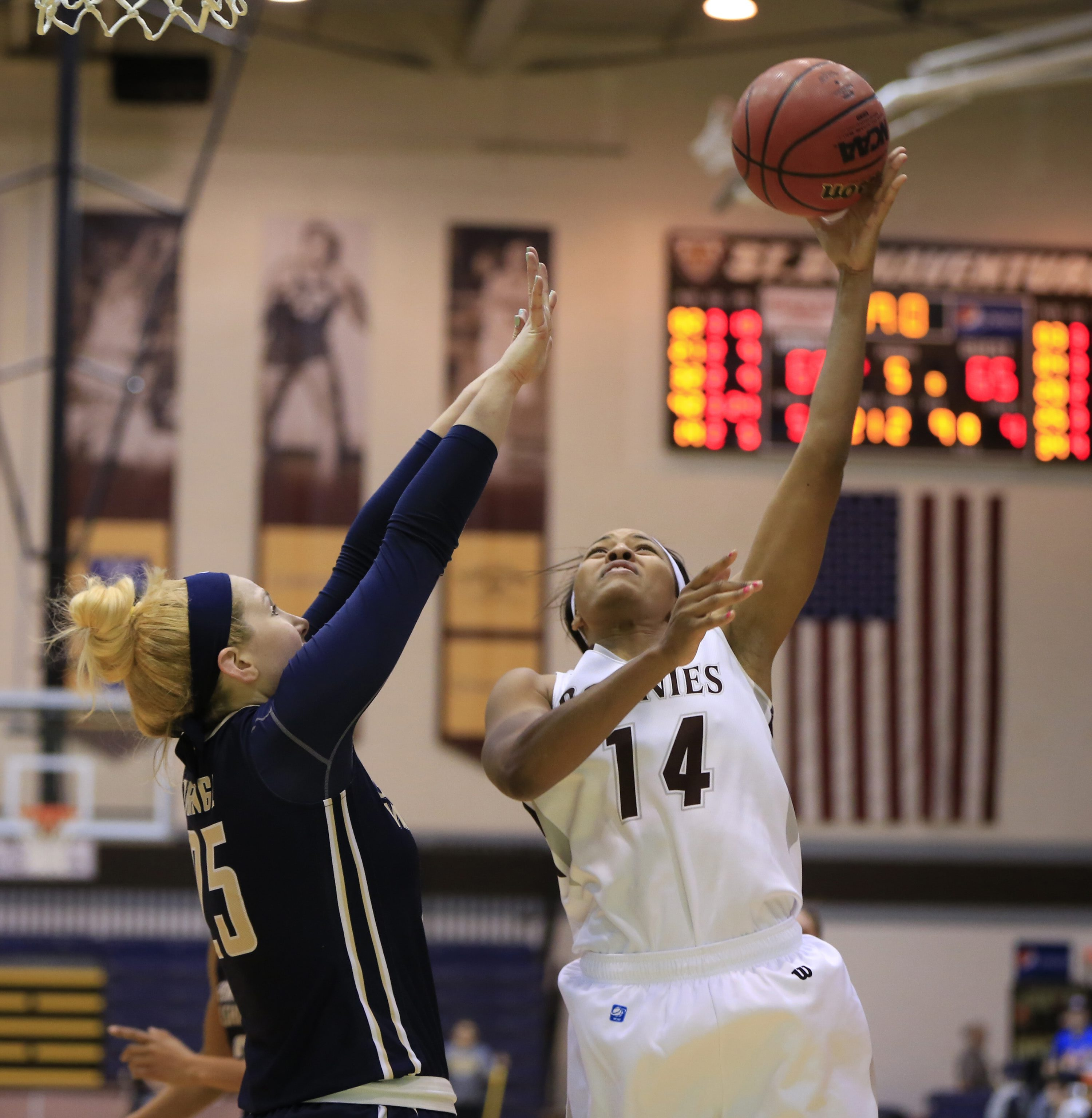 Gabby RIchmond shoots aganst George Washington during overtime action at the Reilly Center on Wednesday, Feb. 17, 2016. (Harry Scull Jr./Buffalo News)