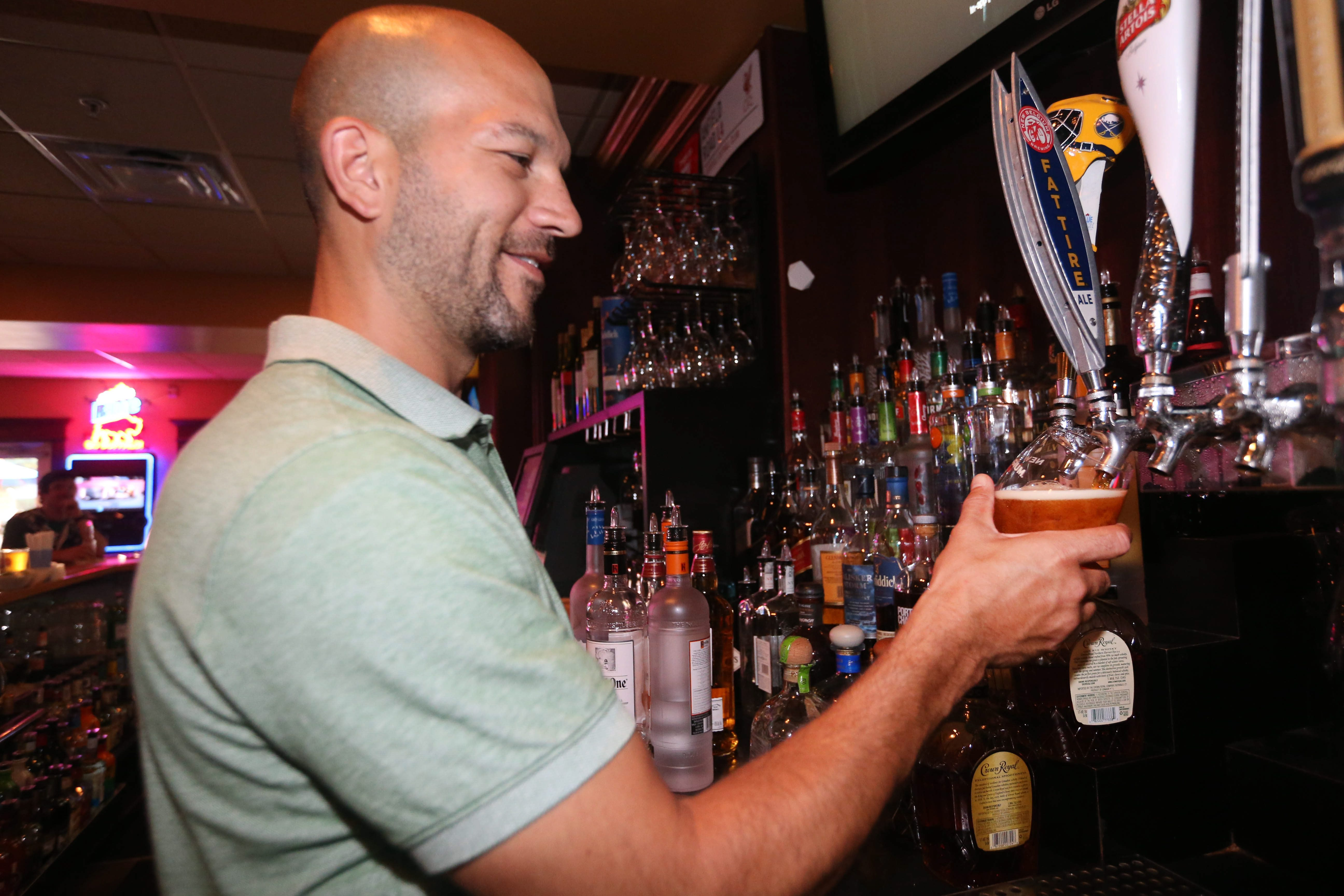 Grab a beer and enjoy the game at JP FItzgerald's in Hamburg. Bartender Timothy Hoak pours a New Belgium Fat Tire Ale. (Sharon Cantillon/Buffalo News file photo)