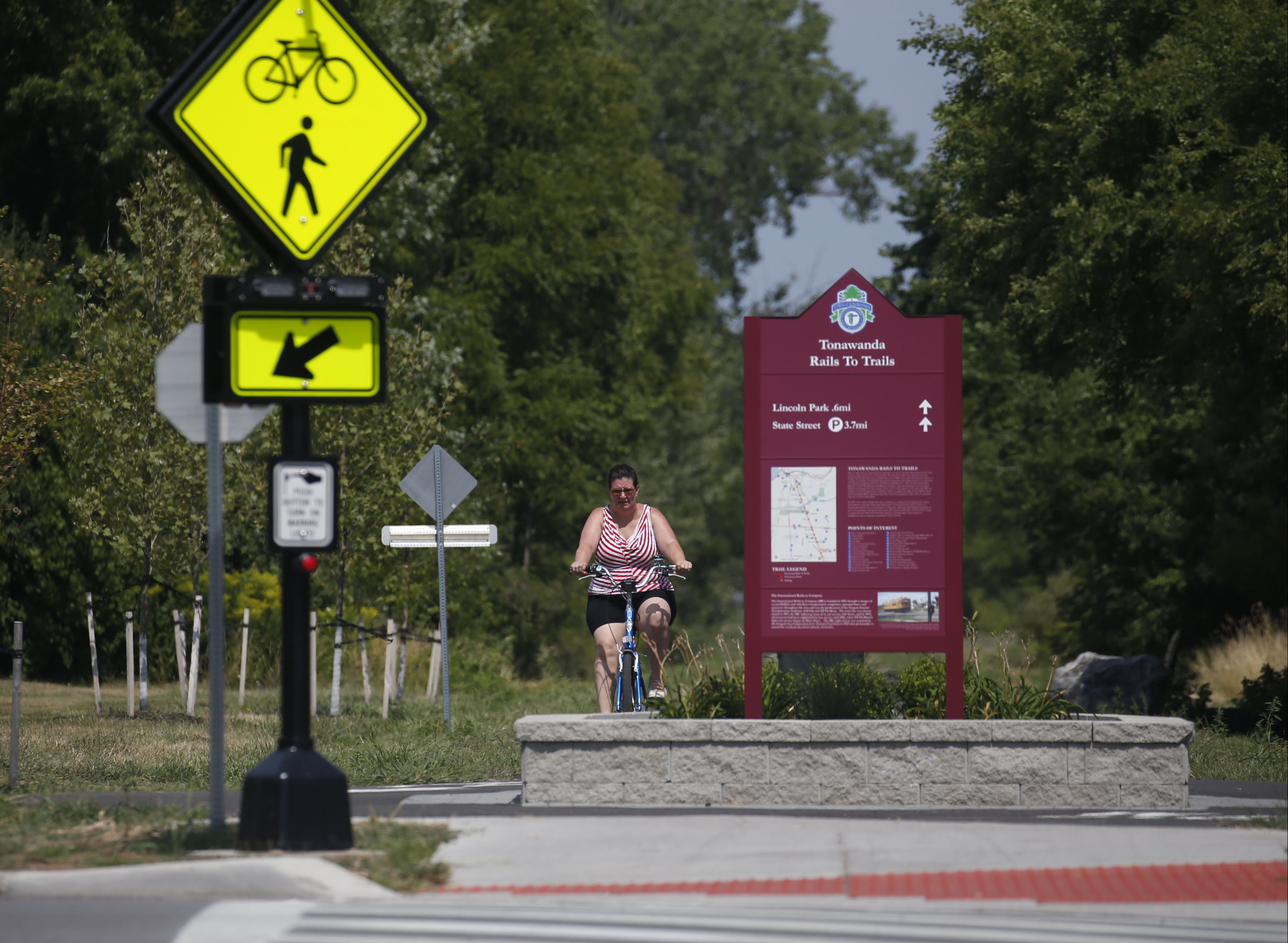 Amy Kempf, of Buffalo, on her bike waits to cross on Englewood Avenue near Parker Boulevard on the Tonawanda Rails to Trails section on Thursday, Aug. 11, 2016. (Robert Kirkham/Buffalo News)