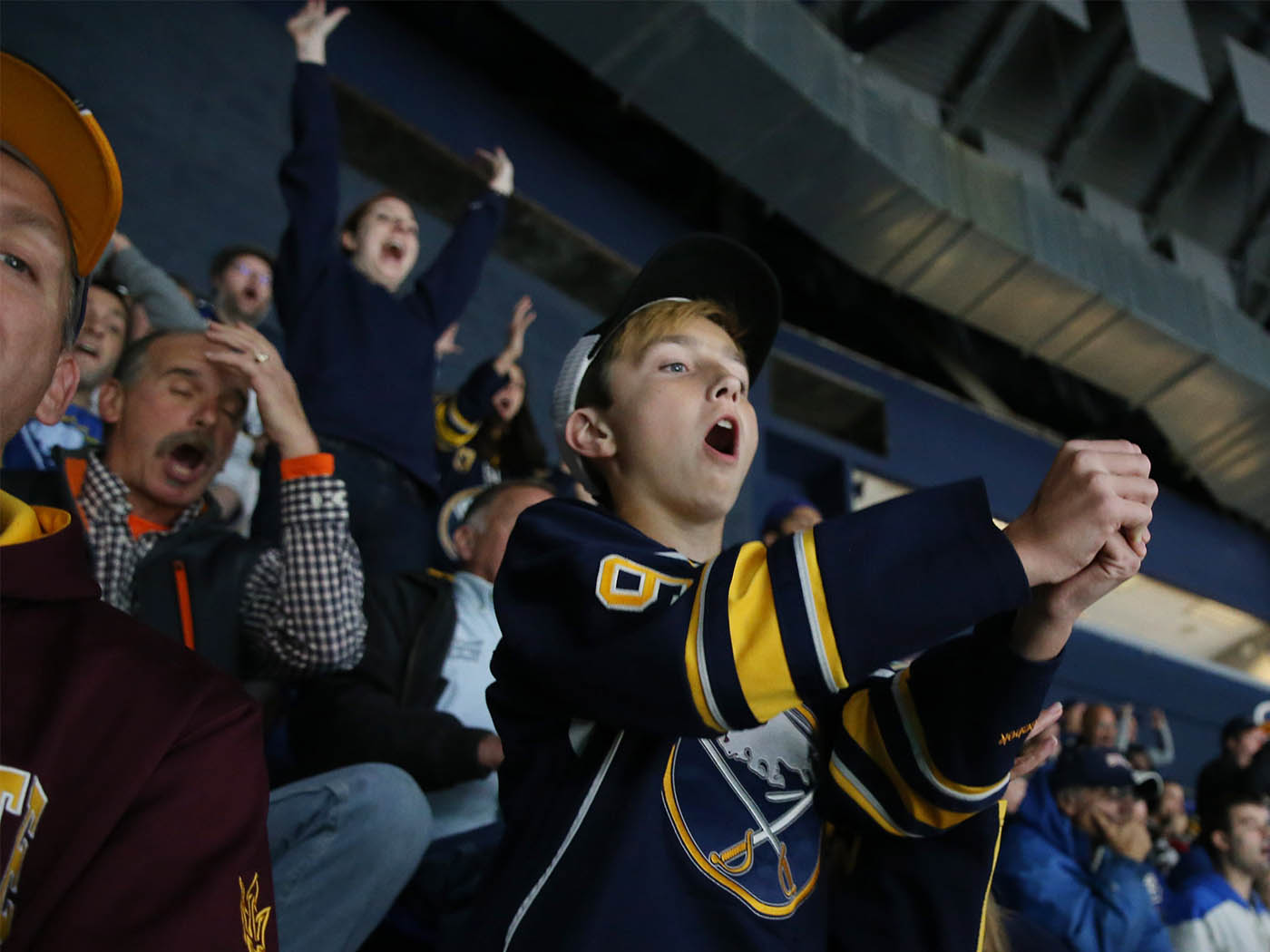 If you're a Sabres fan or a Maple Leafs fan, you don't want to miss the rivalry game. With Toronto fans flooding KeyBank Center, it's hard to tell who's the home team, but it makes for an interesting night of hockey, Thursday, Nov. 3, 2016. So close! Sabres fan Jameson Brunn, 13, thought he was going to celebrate a goal, but no such luck. (Sharon Cantillon/Buffalo News)