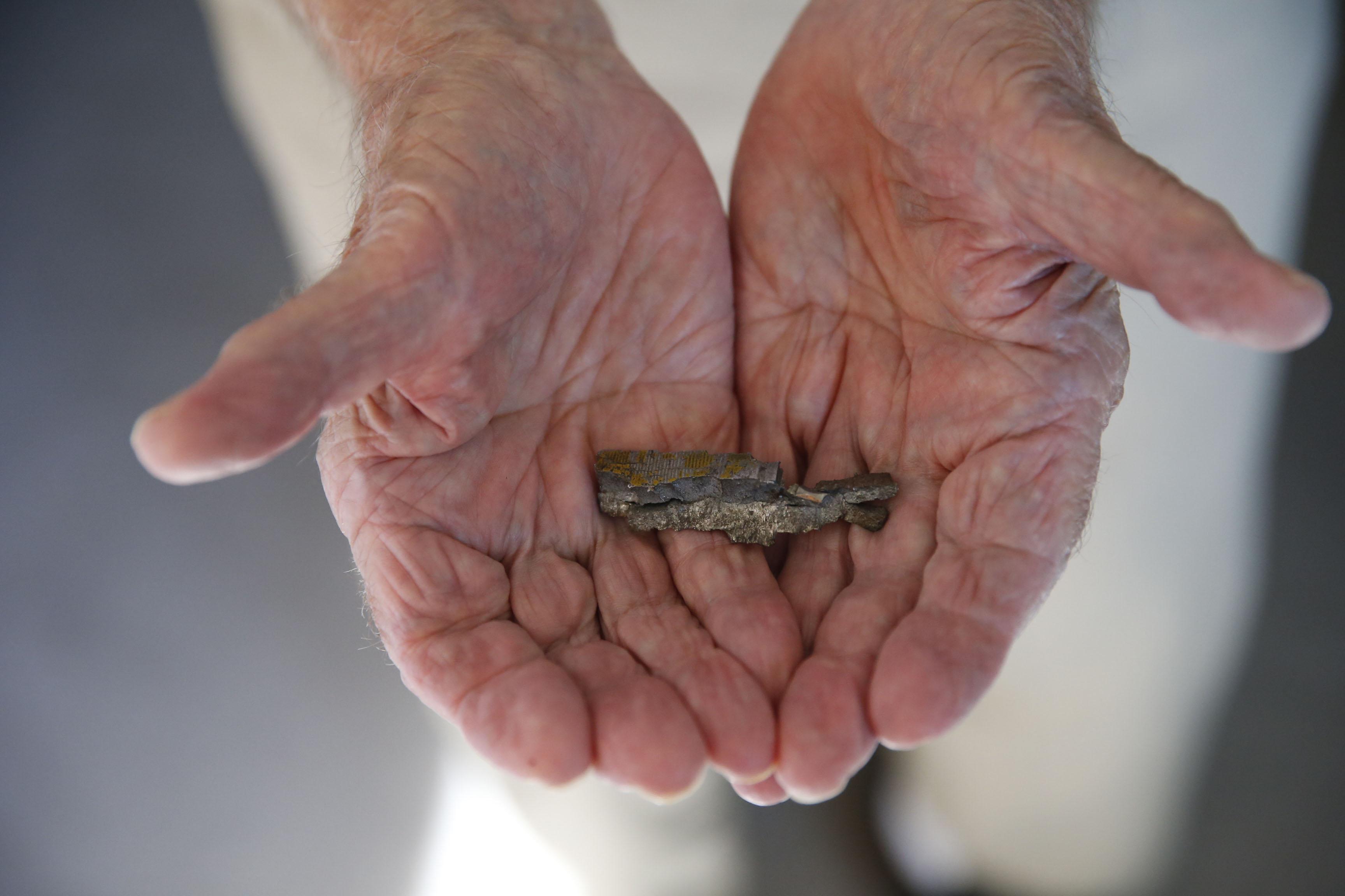 World War II Army Air Corps vet Edward H. Kaczmarek has a piece of flak he kept from one of the 51 bombing runs he participated in. The flak from German anti-aircraft guns. Friday, Oct. 7, 2016. (Robert Kirkham/Buffalo News)