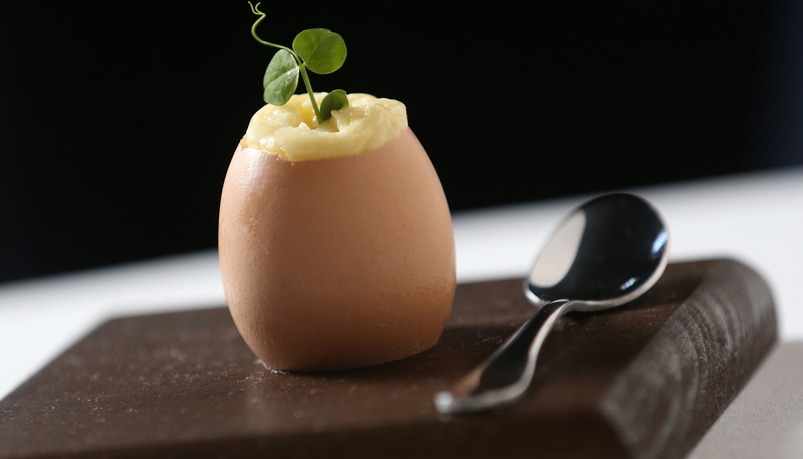 Oliver's first course is Decadence of Eggs, which is egg yolk custard, crispy pancetta truffle and hot potato foam. (Sharon Cantillon/Buffalo News)